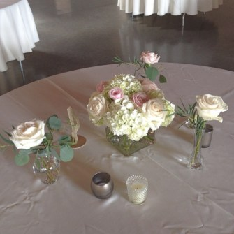 soft pink & white centerpiece with surround bud vases
