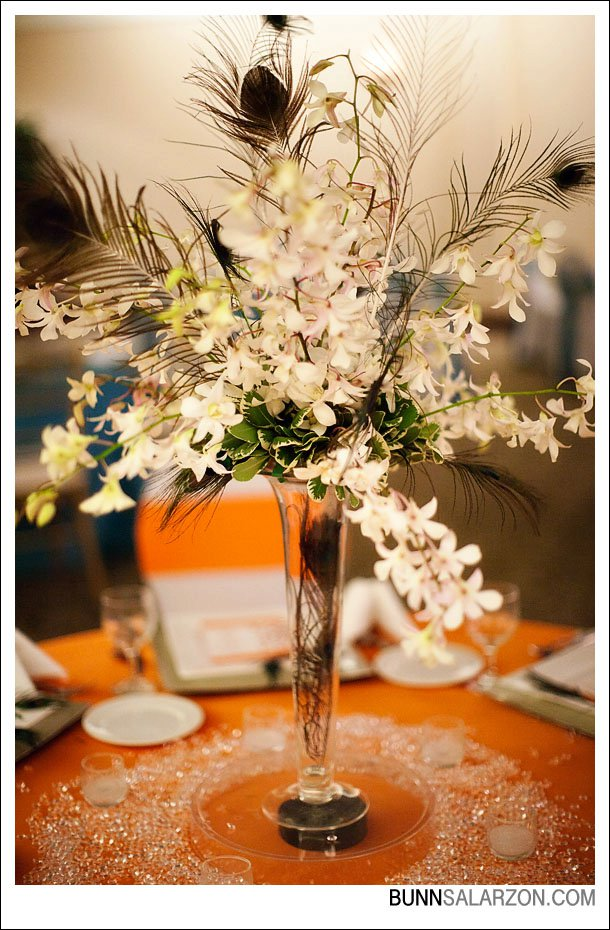 Flower arrangements gallery floral sunshine white dendrobium orchids peacock feathers in tall wedding centerpiece mightylinksfo
