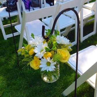 hanging flowers in hobnail jars from shepherd hooks