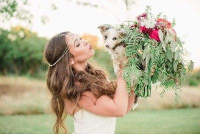 bride with a puppy and bridal bouquet