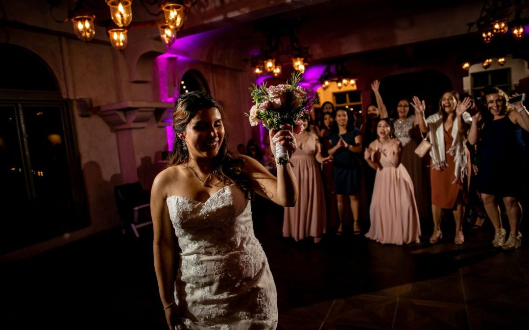 a bride tossing the bouquet