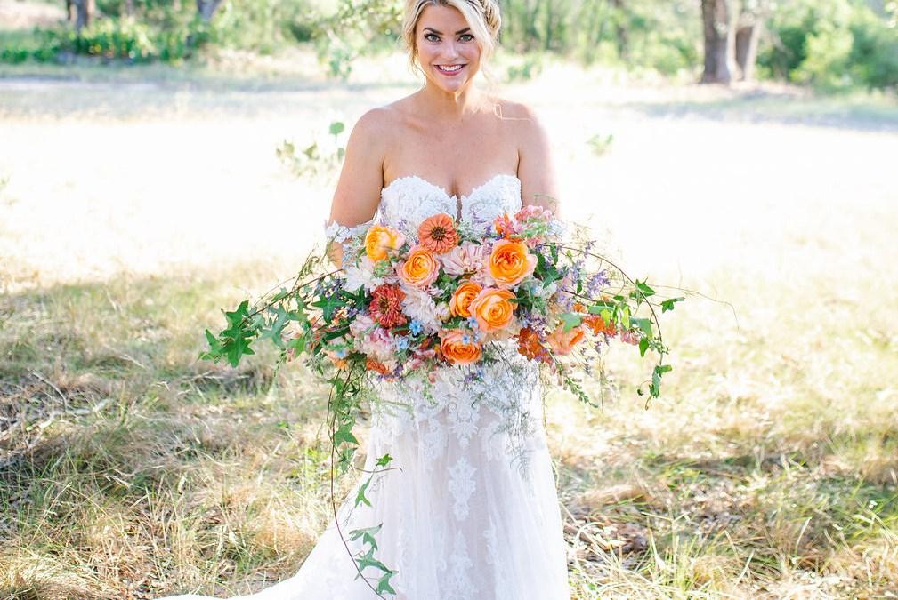 bride with a summer flower bouquet