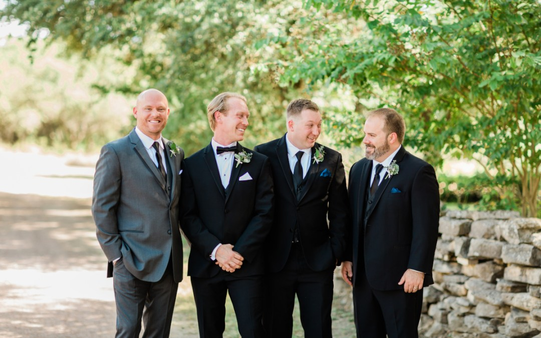 groom and groomsmen in wedding suits
