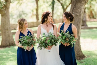 bride and bridesmaids with greenery bouquets