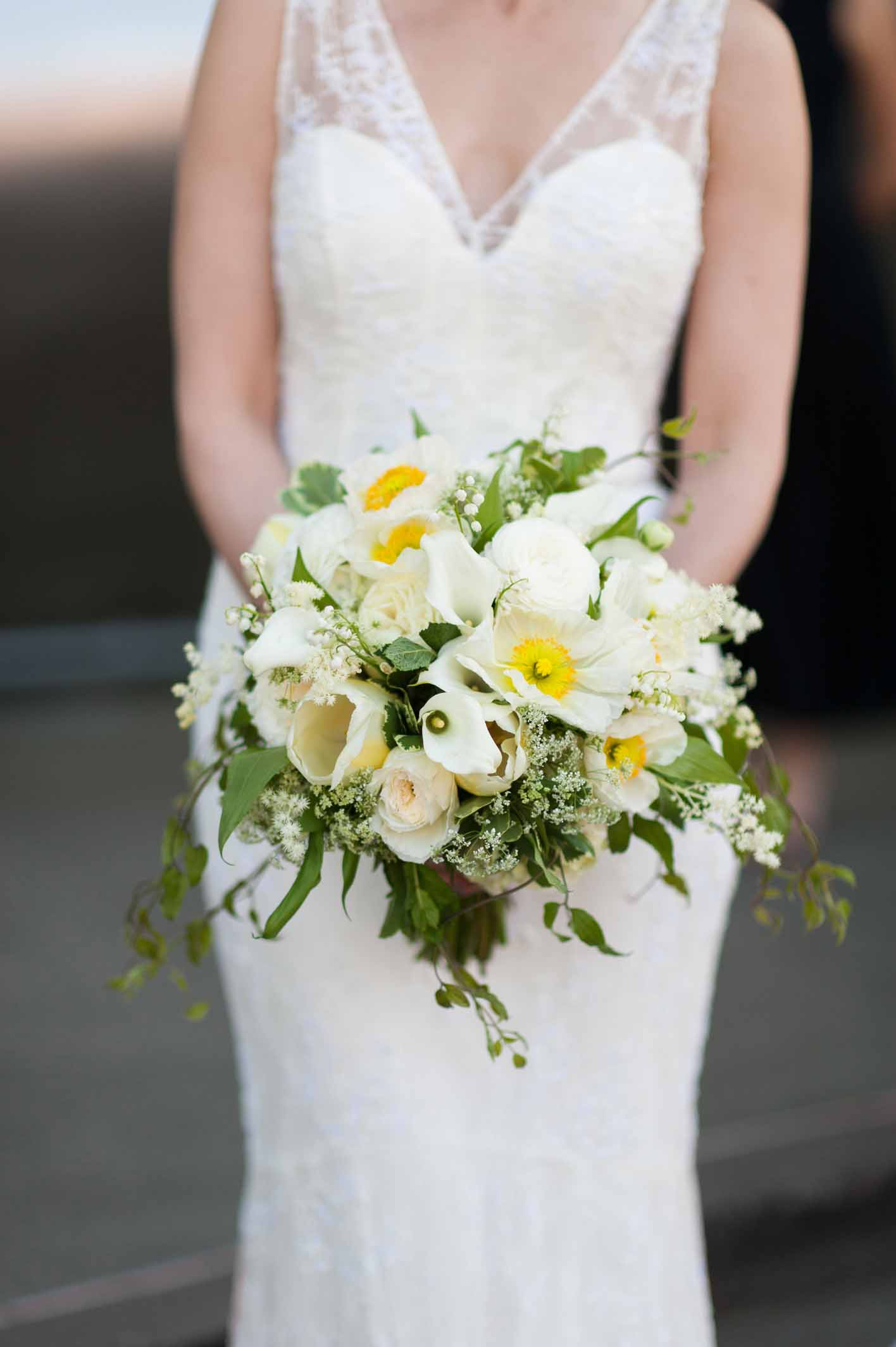 Beautiful white and orange spring bouquet, with poppies, tulips, ranunculus, roses, and crisp spring foliage - Chihuly Garden and Glass Wedding - Flora Nova Design Seattle