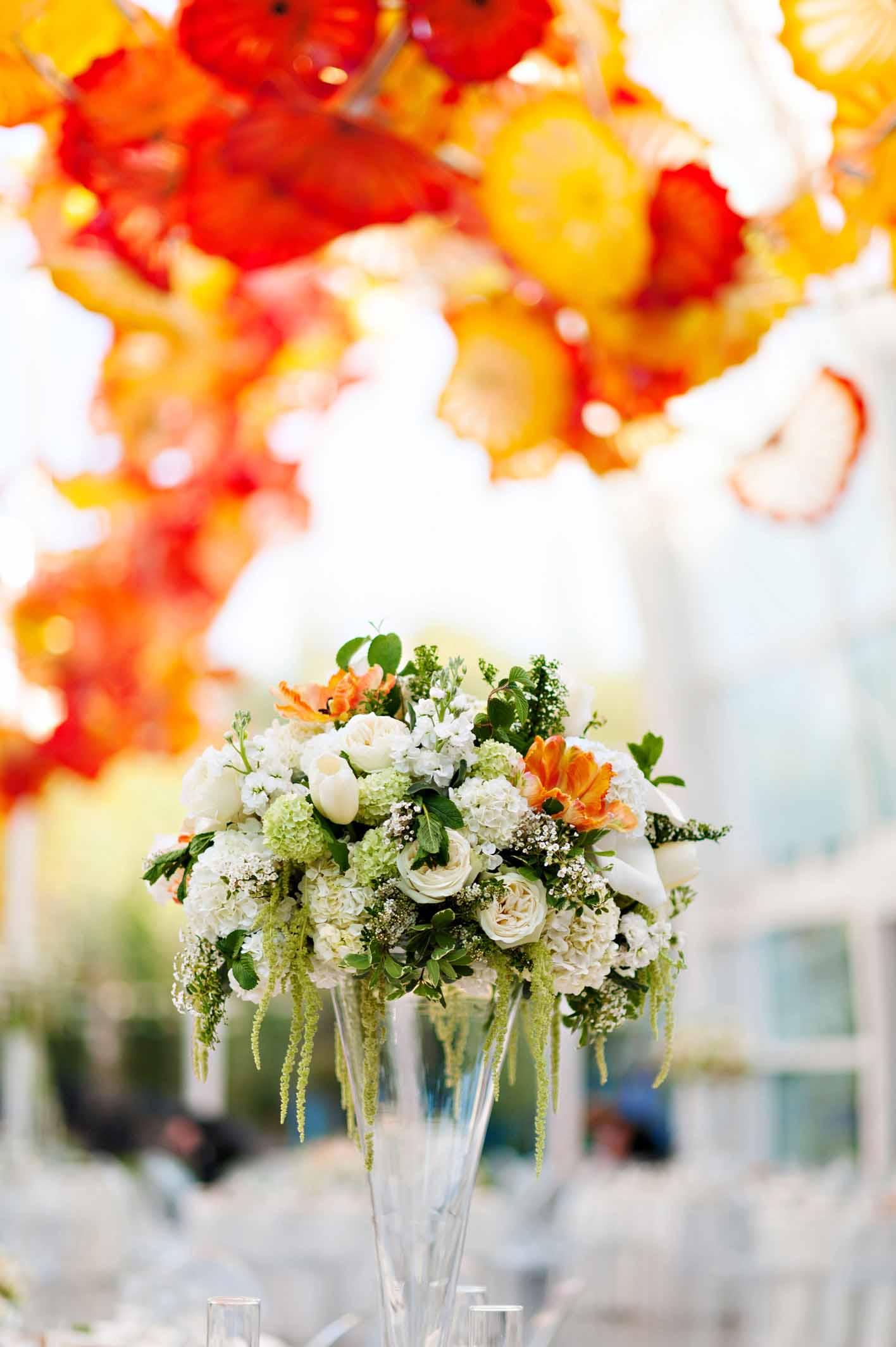Large spring flower arrangement at Chihuly Garden and Glass wedding - designed by Flora Nova Design