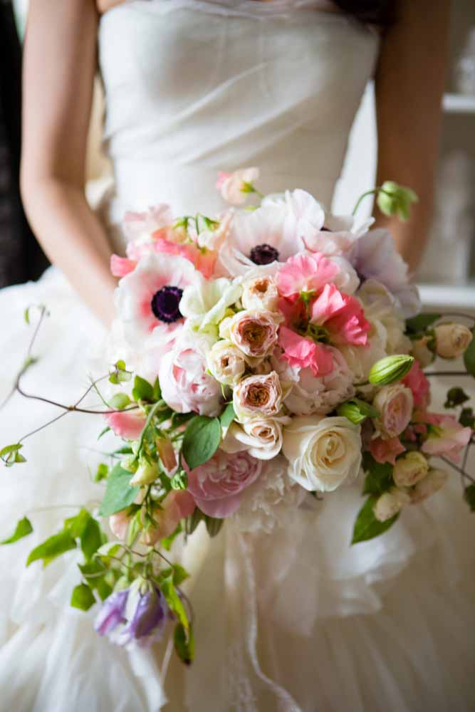 Romantic bridal bouquet of anemones, garden roses, spray roses, and blooming clematis vines - by Flora Nova Design Seattle