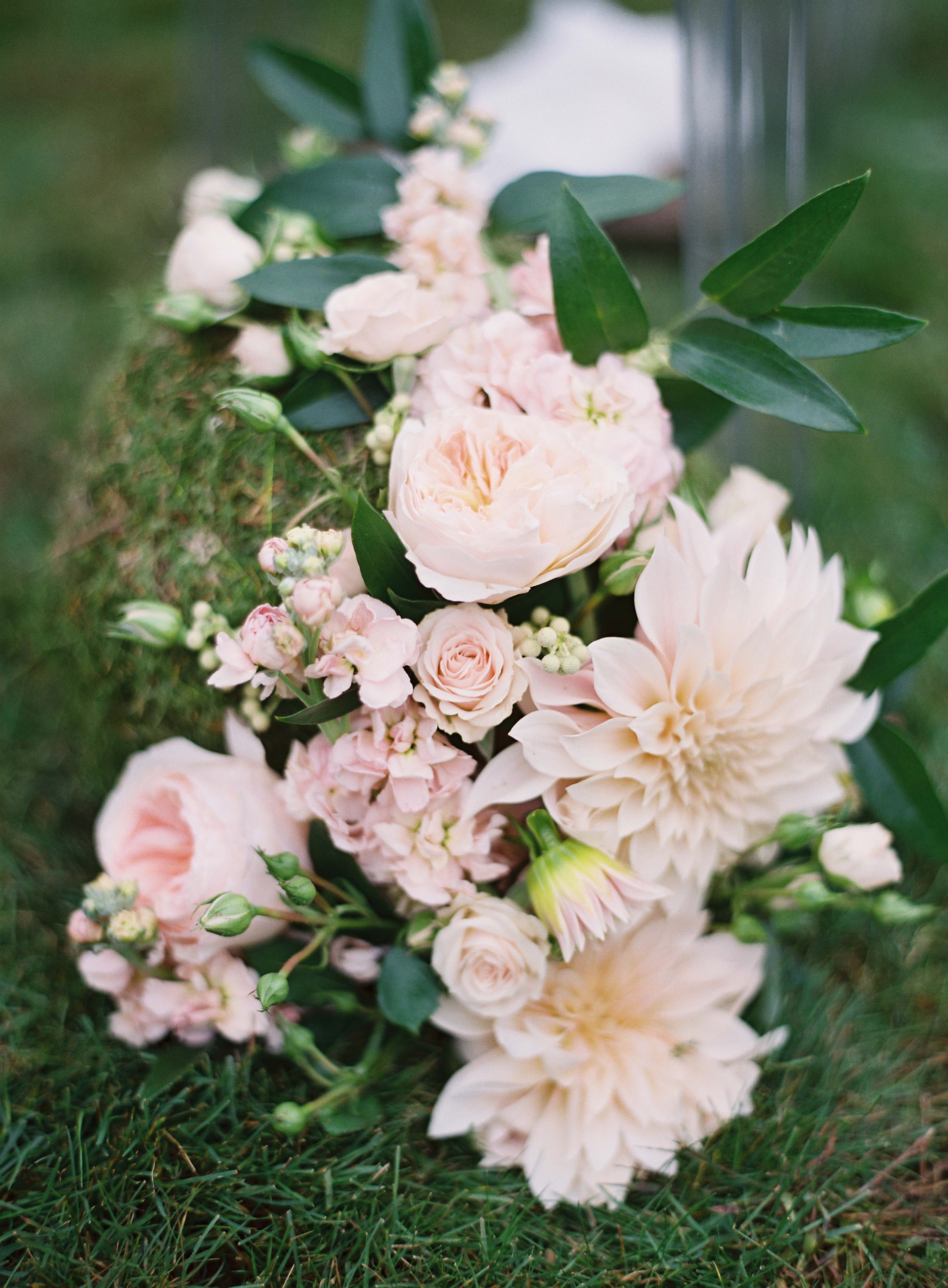 Peach flowers, cafe au lait dahlias, Juliet garden roses, peach stock on moss ball as ceremony aisle decor