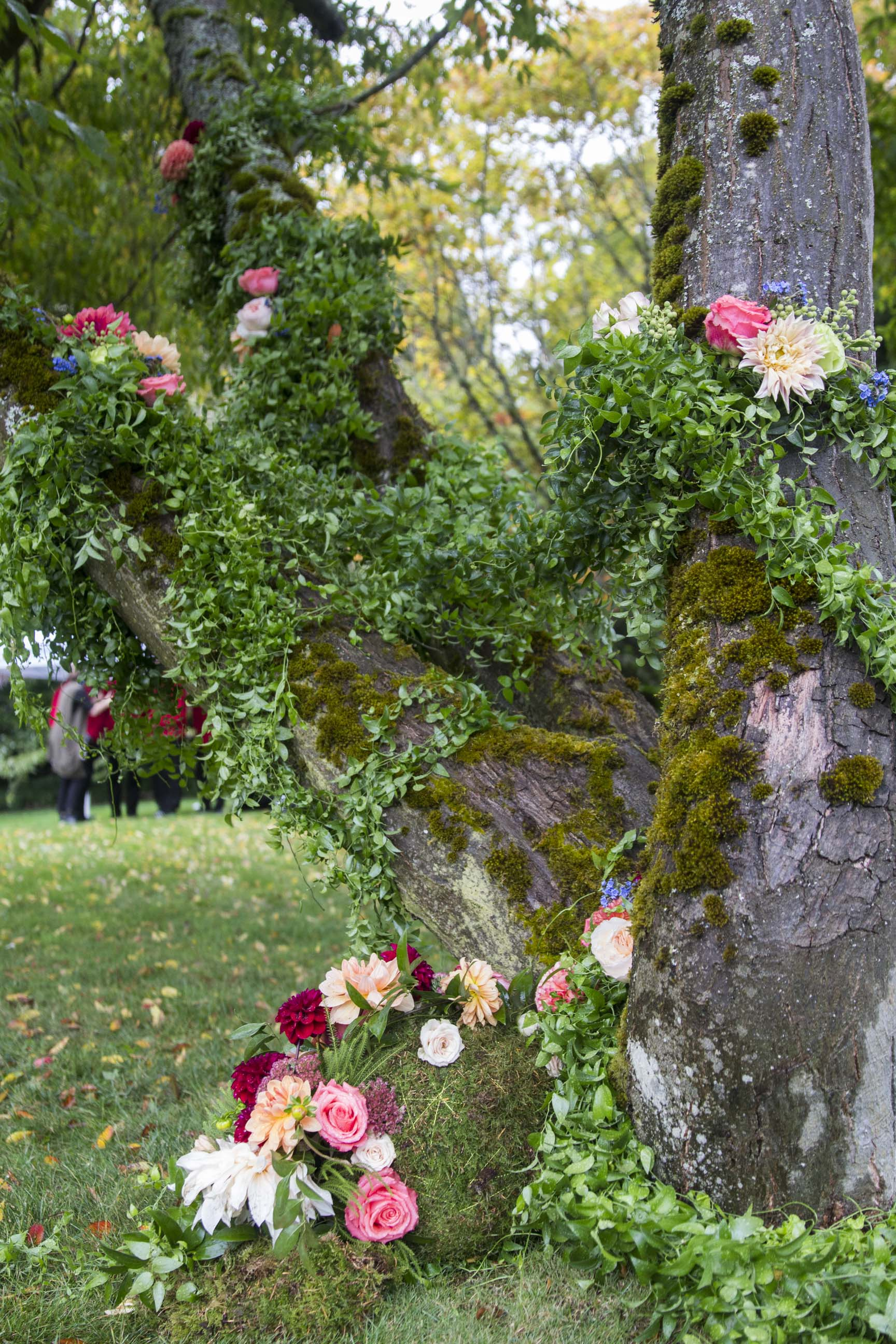 greenery and flowers draping a large tree