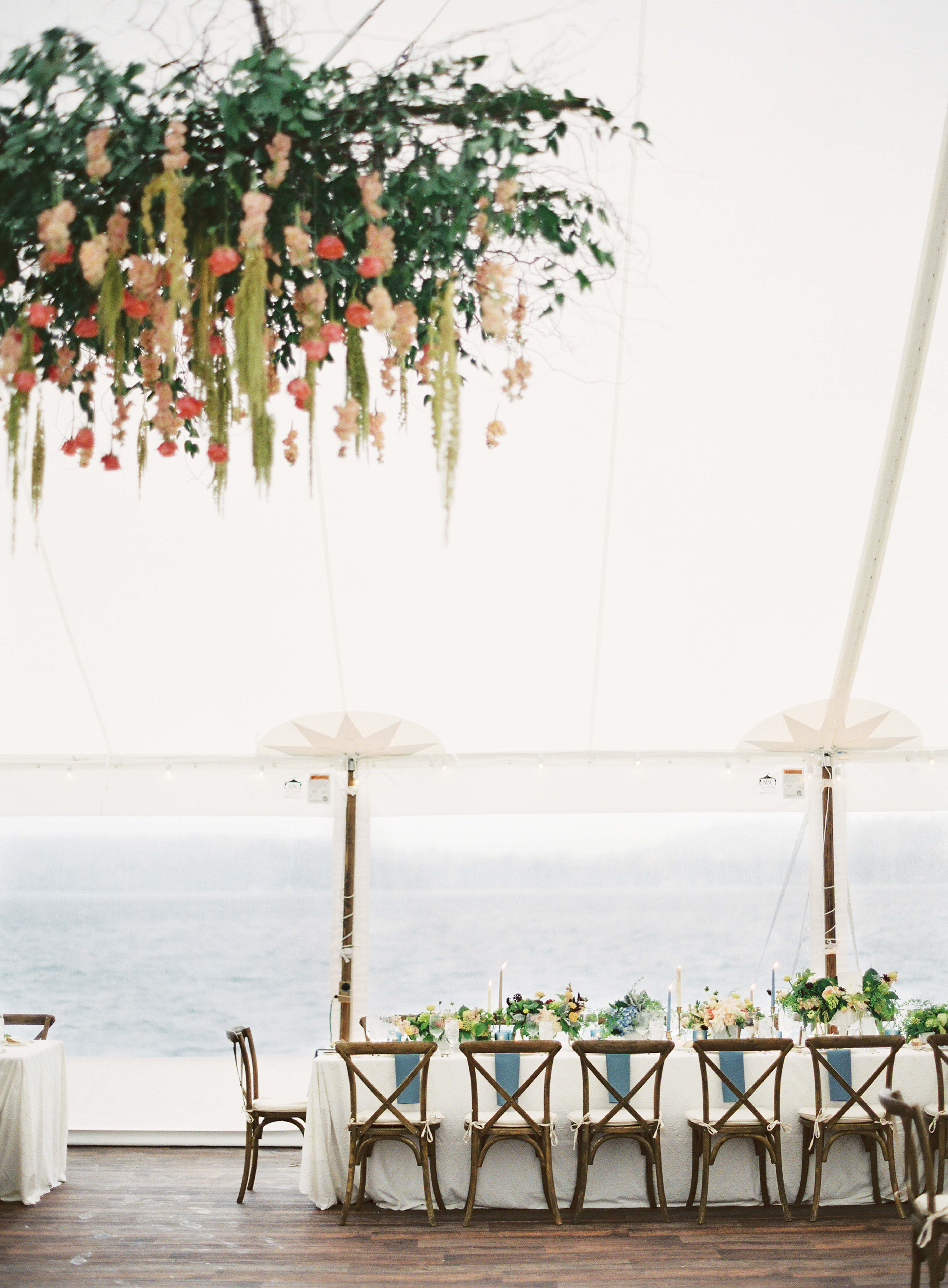 Tent wedding with huge floral chandelier at Pacific Northwest wedding