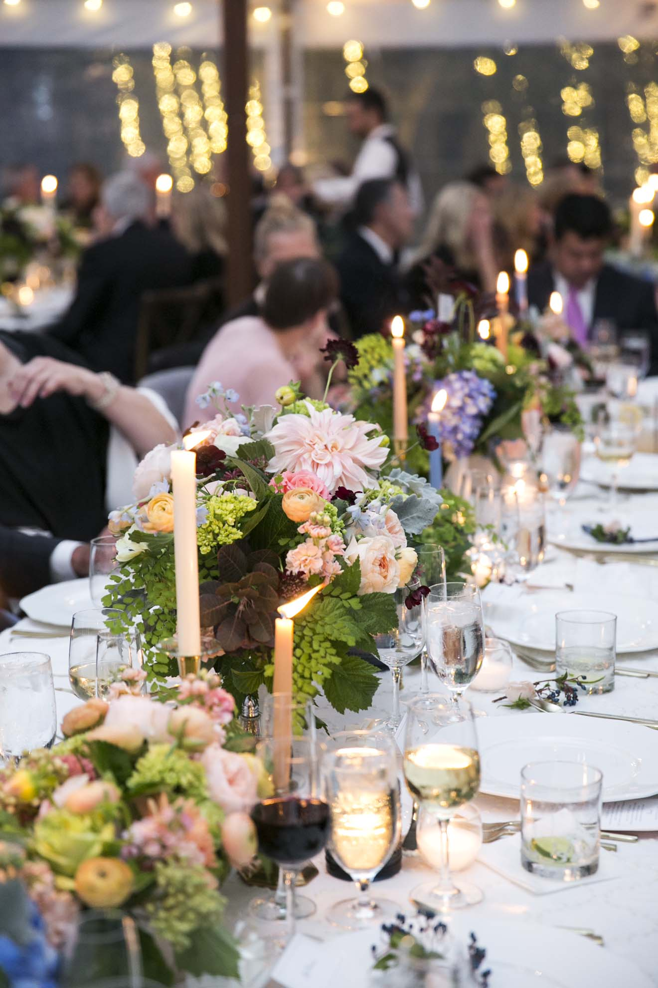 Candle lit wedding reception table