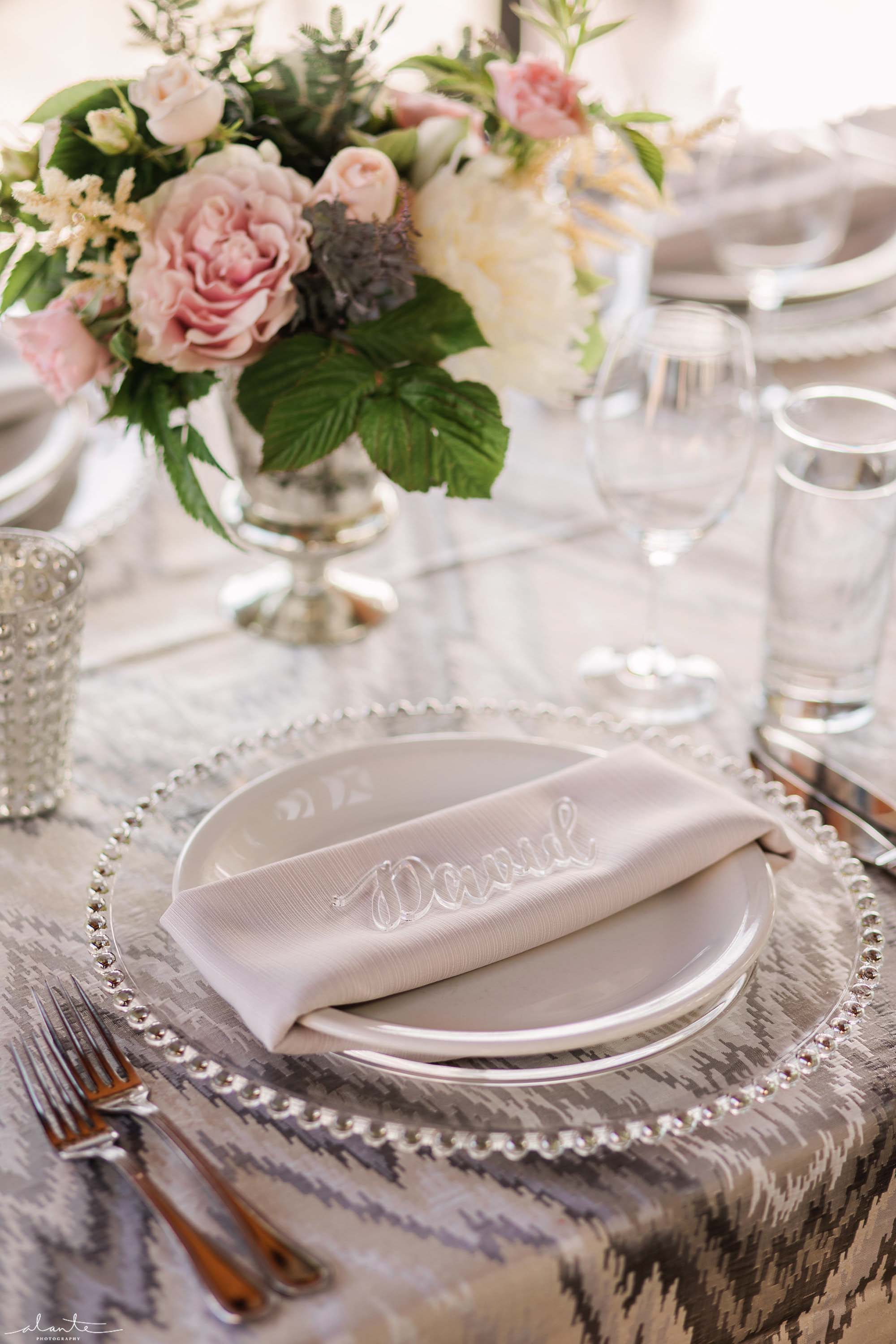 Place setting with lucite escort card and flowers - Olympic Rooftop Pavilion wedding with pink peonies by Flora Nova Design Seattle