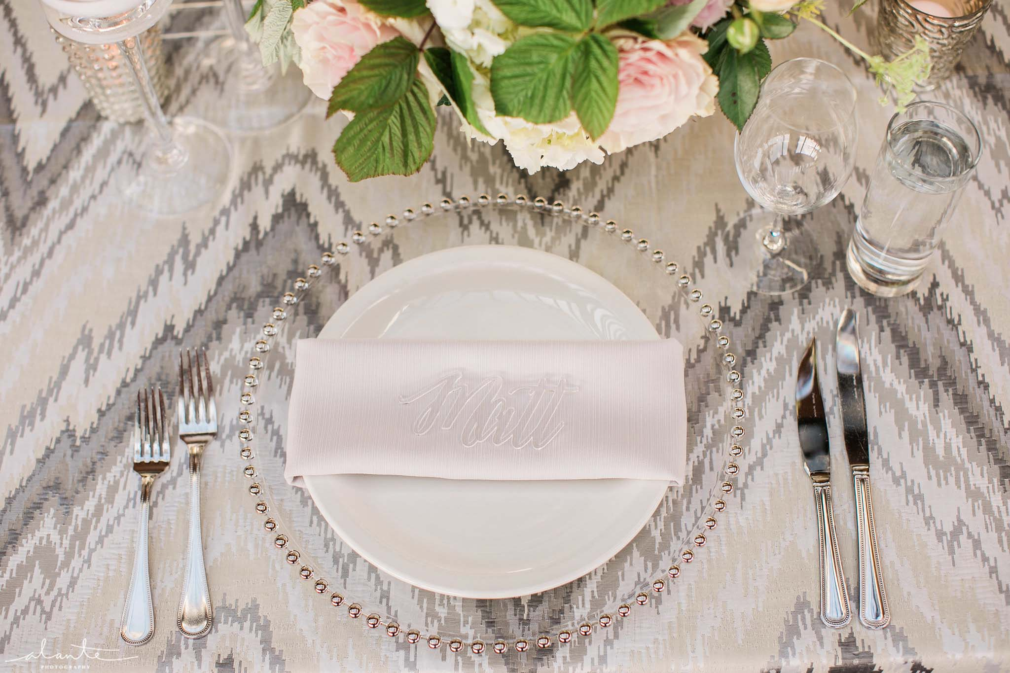 Place setting with beaded charger plate and lucite name card, Olympic Rooftop Pavilion wedding with pink peonies by Flora Nova Design Seattle