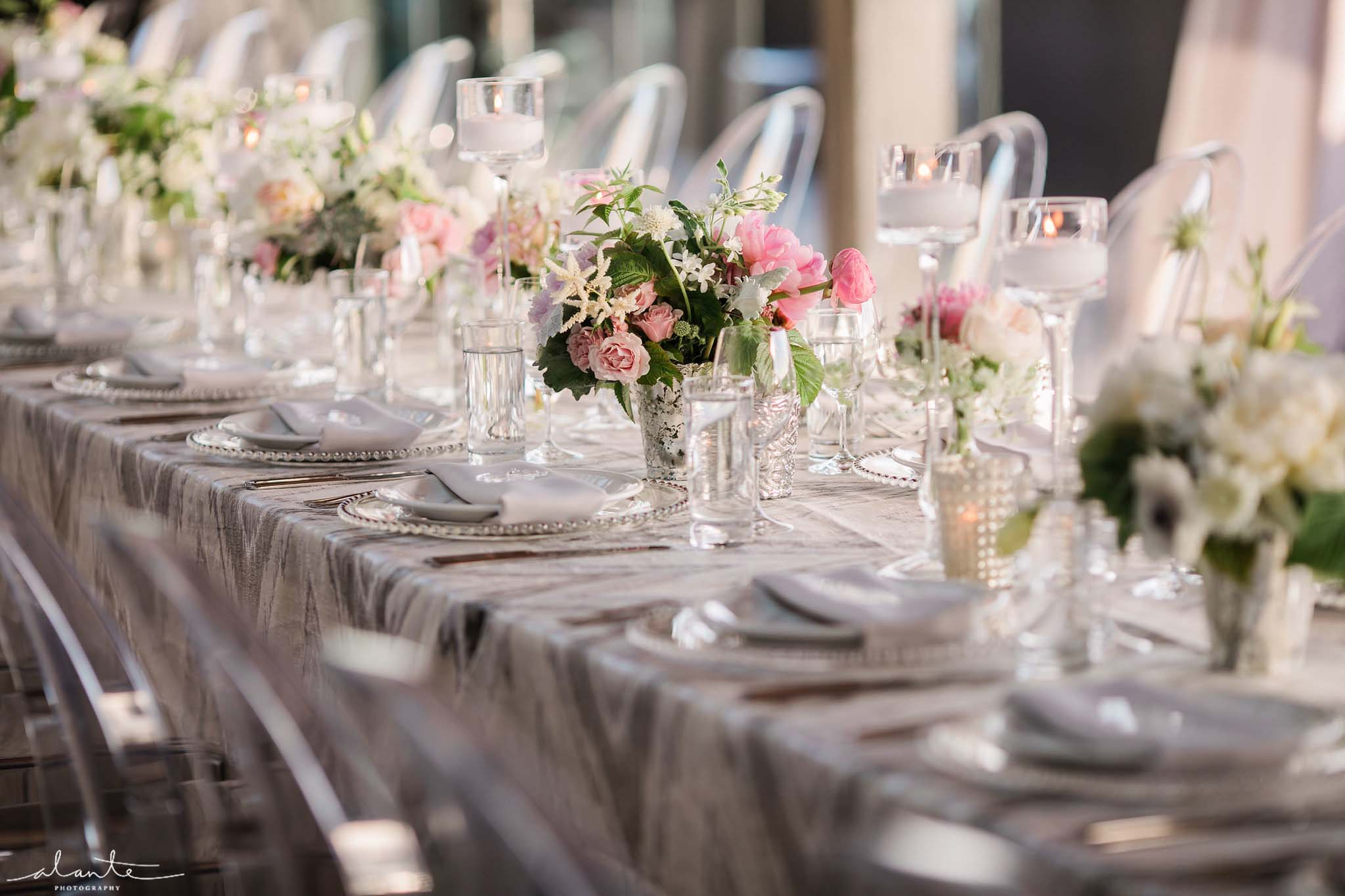 Long table lined with pink flowers and silver linen - Olympic Rooftop Pavilion wedding with pink peonies by Flora Nova Design Seattle