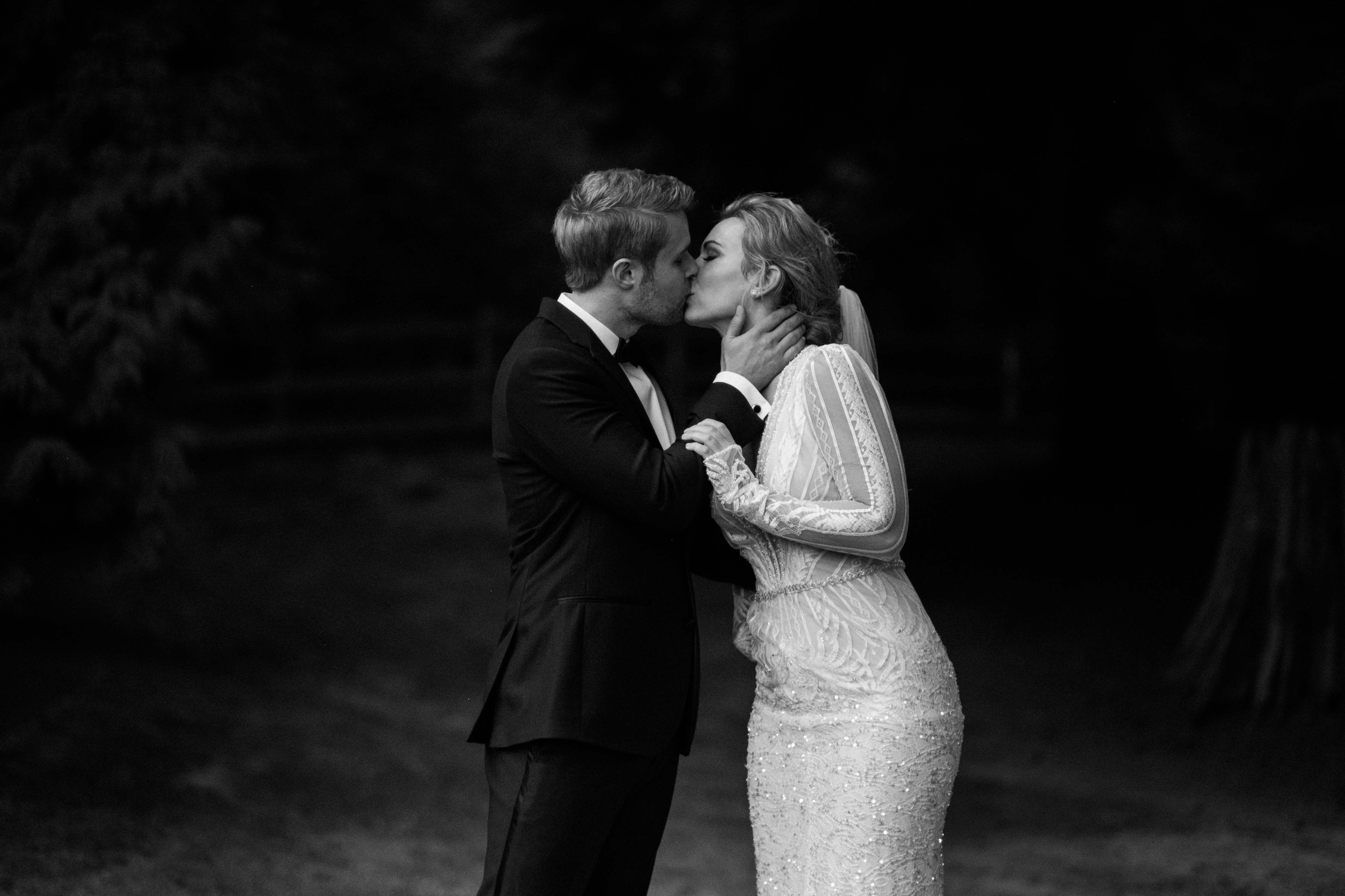 Bride and groom kissing at Chateau Lill
