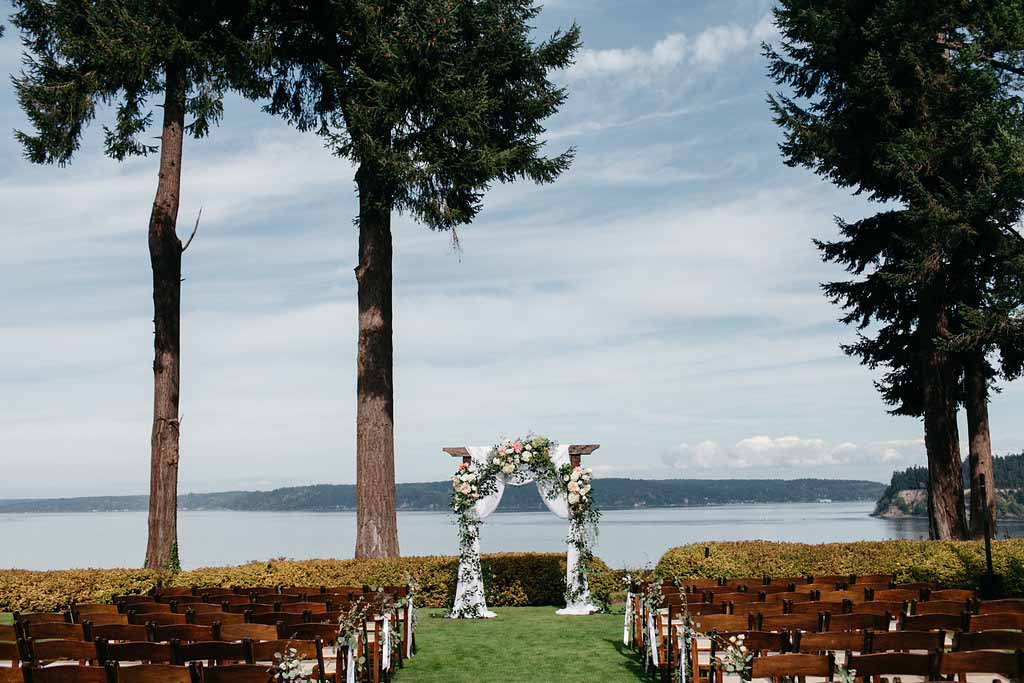 A wedding arbor covered in greenery and blooms - Elegant Seattle Garden Wedding by Flora Nova Design Seattle