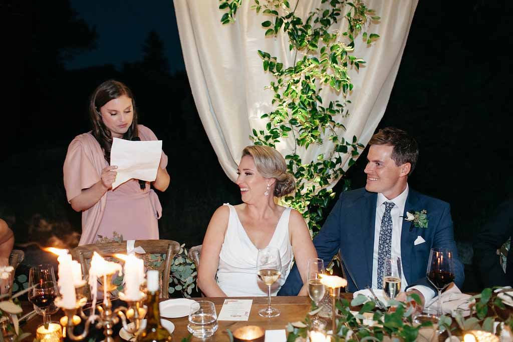 Bride and groom at their head table decorated with greenery, Flora Nova Design Seattle