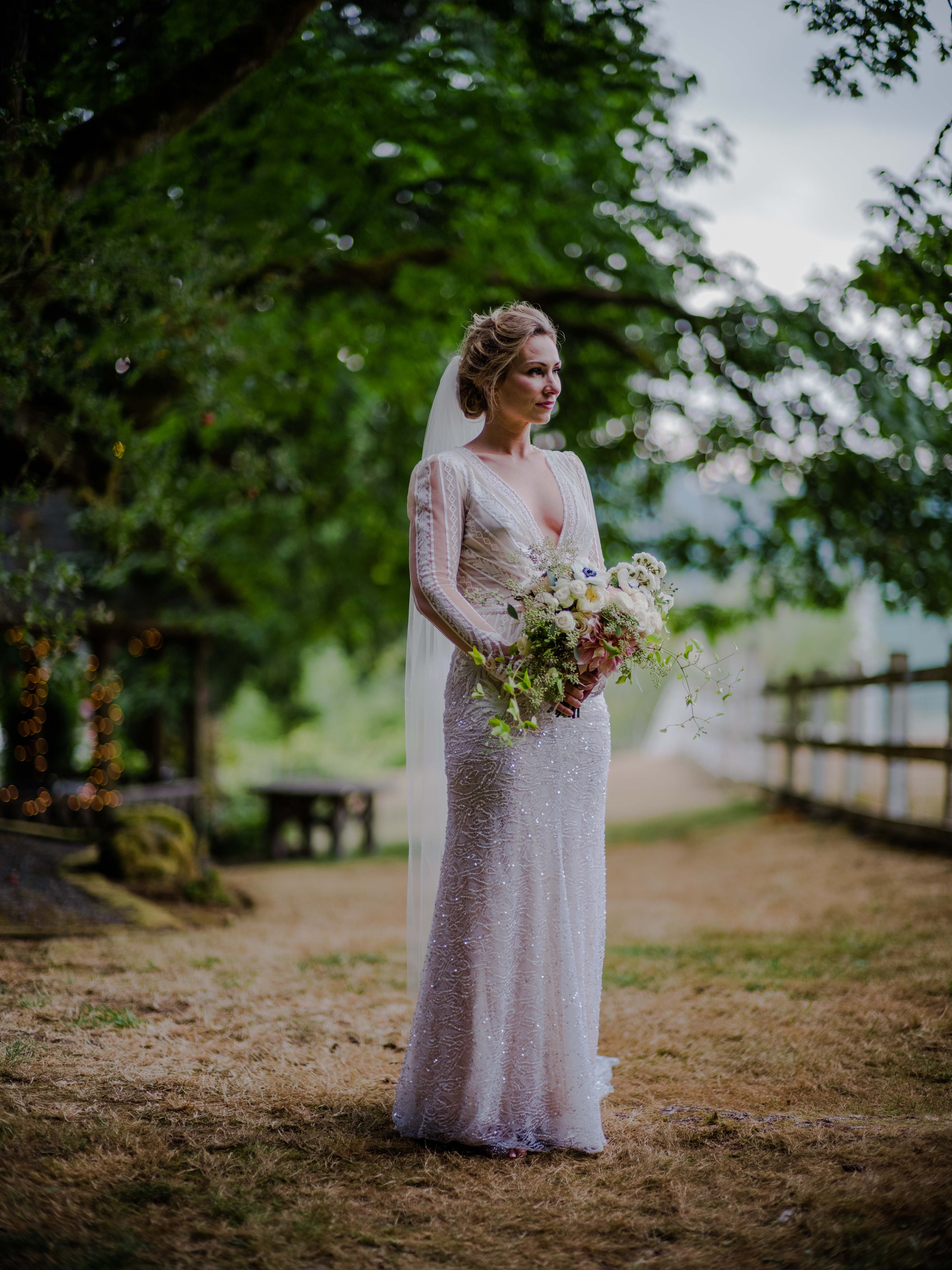 A bride at Chateau Lill - A Luxe Garden Wedding at Chateau Lill by Flora Nova Design Seattle