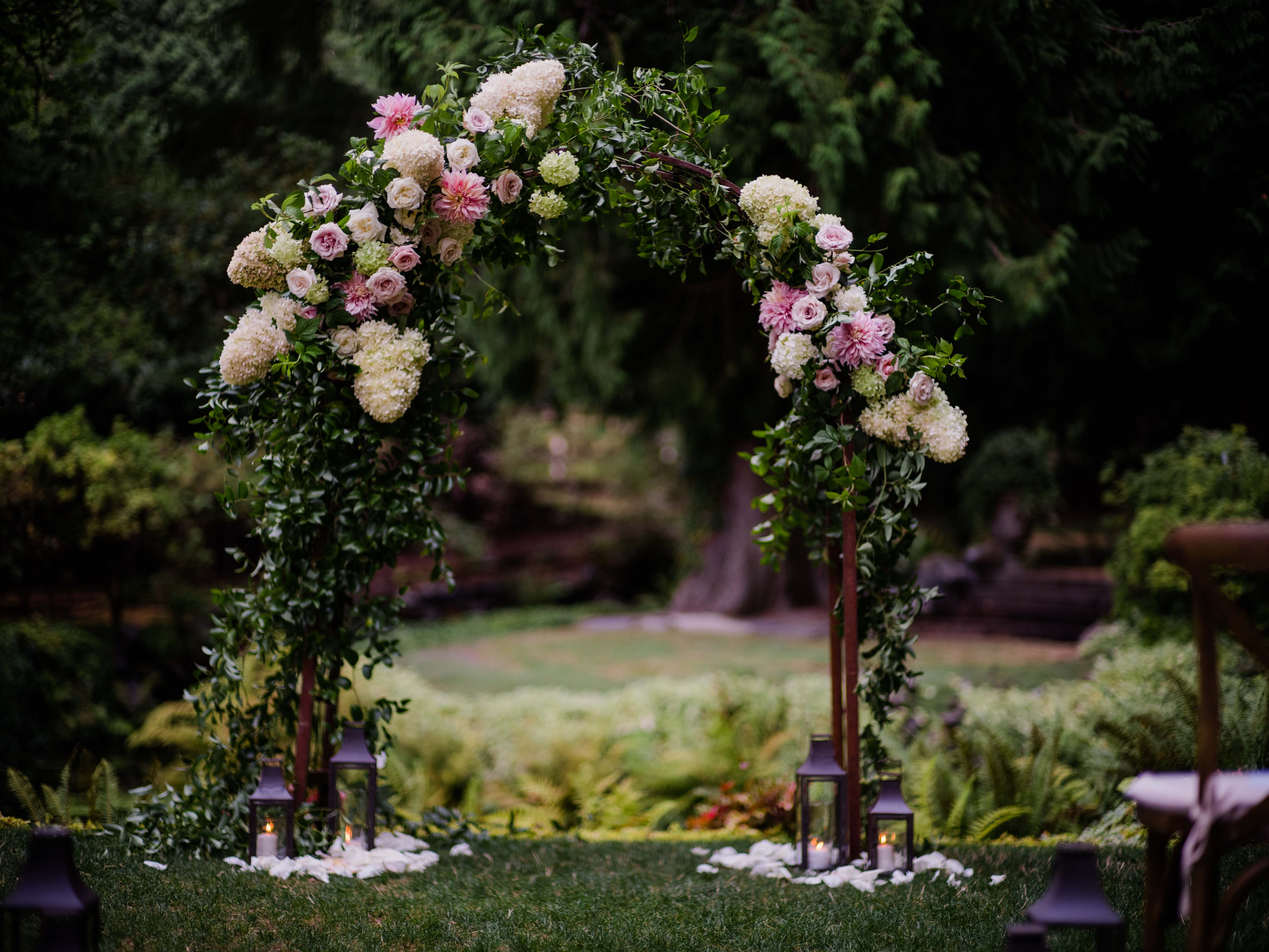 Wedding arch covered in greenery and blush flowers - A Luxe Chateau Lill Wedding designed by Flora Nova Design Seattle