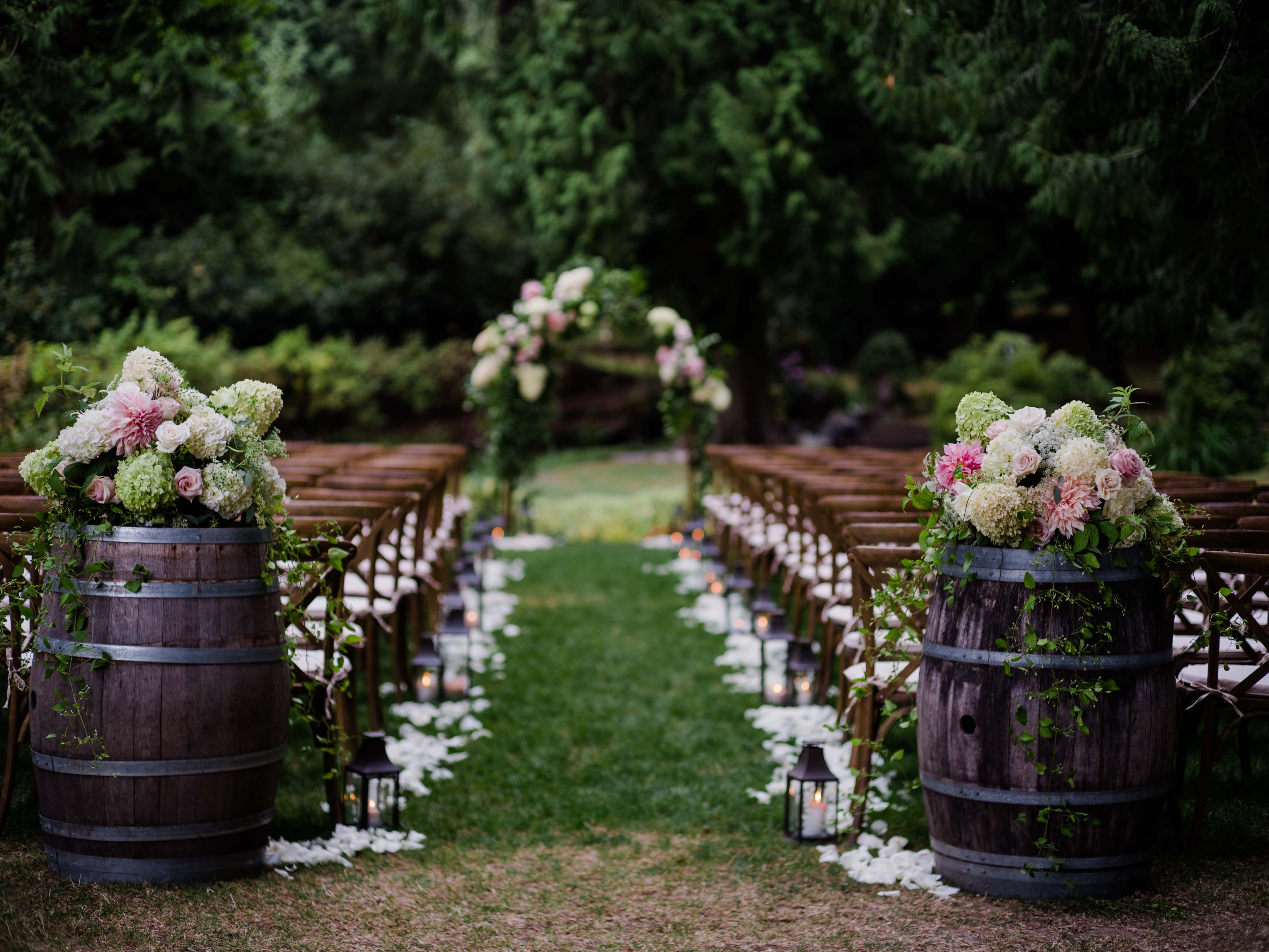 Wedding ceremony with arch - A Luxe Chateau Lill Wedding designed by Flora Nova Design Seattle