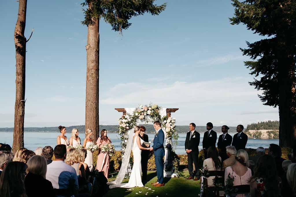 Wedding ceremony at a Seattle garden wedding under trees - Elegant Seattle Garden Wedding by Flora Nova Design Seattle