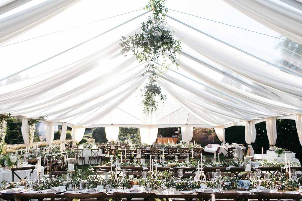 Tent wedding with greenery and long wooden tables - Elegant Seattle Garden Wedding by Flora Nova Design Seattle
