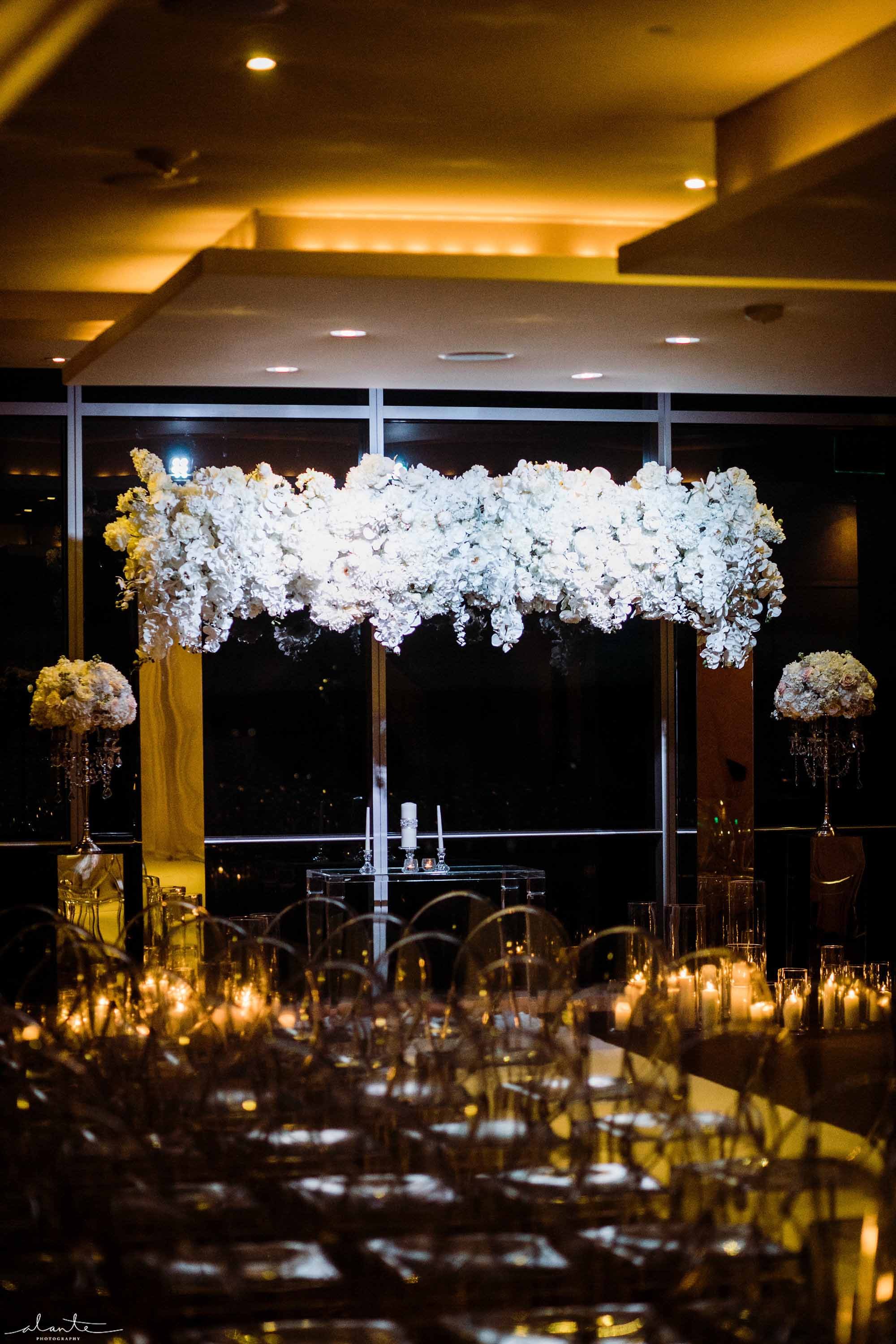 A glamorous wedding ceremony arch covered in white orchids at this Four Seasons Seattle wedding - Luxury Winter Wedding at the Four Seasons by Flora Nova Design Seattle