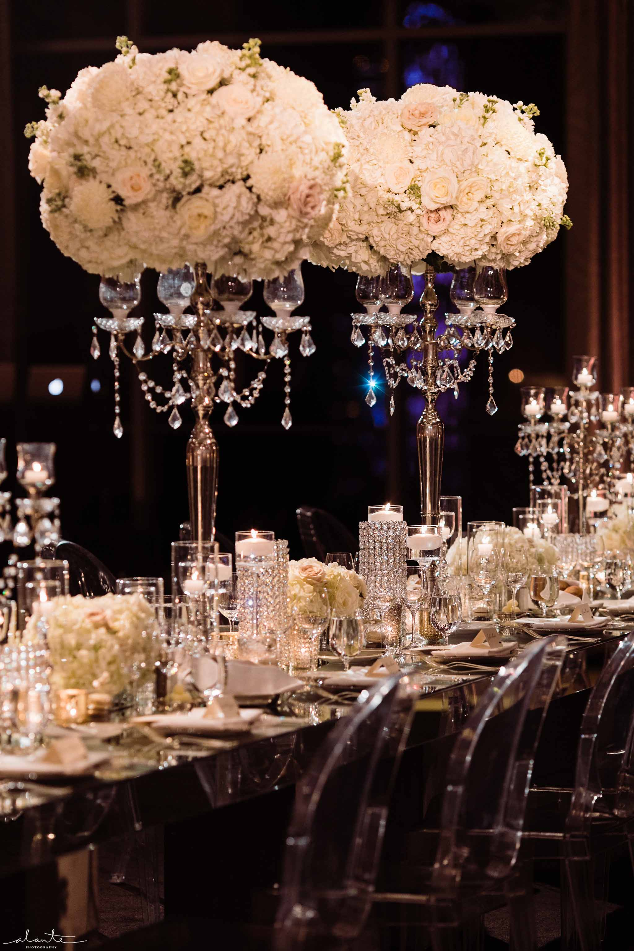 Long head table with elevated white centerpieces on crystal candelabras - Luxury Winter Wedding at the Four Seasons by Flora Nova Design Seattle