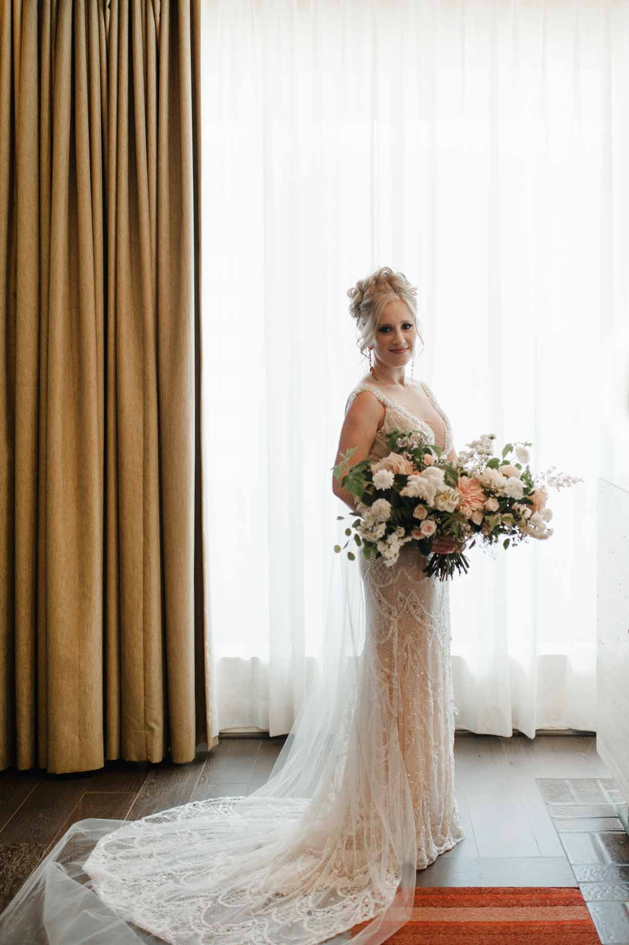 Beautiful bride with a beautifully large bouquet, designed by Flora Nova Design Seattle