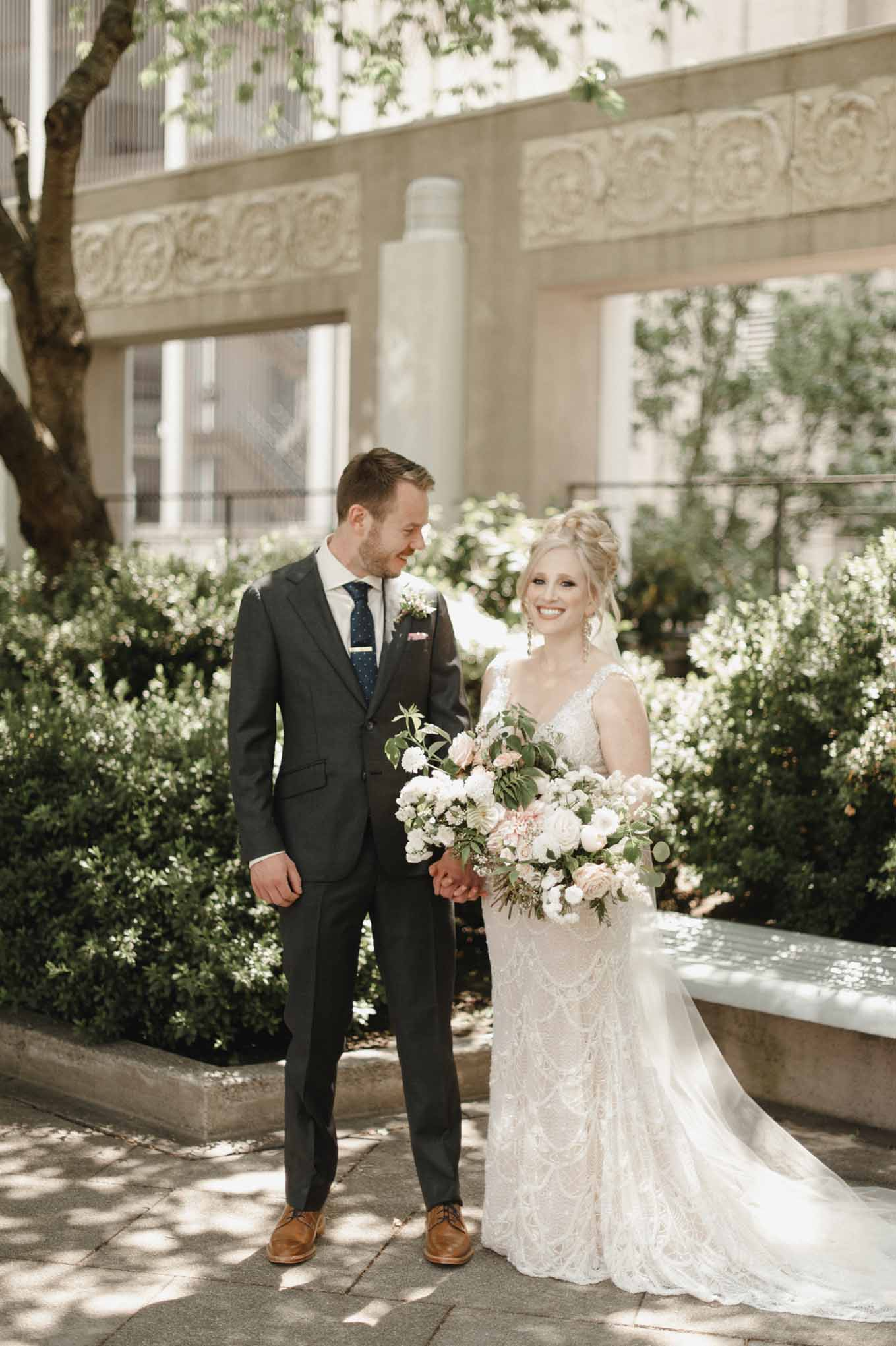 Bride and groom with large bouquet, designed by Flora Nova Design