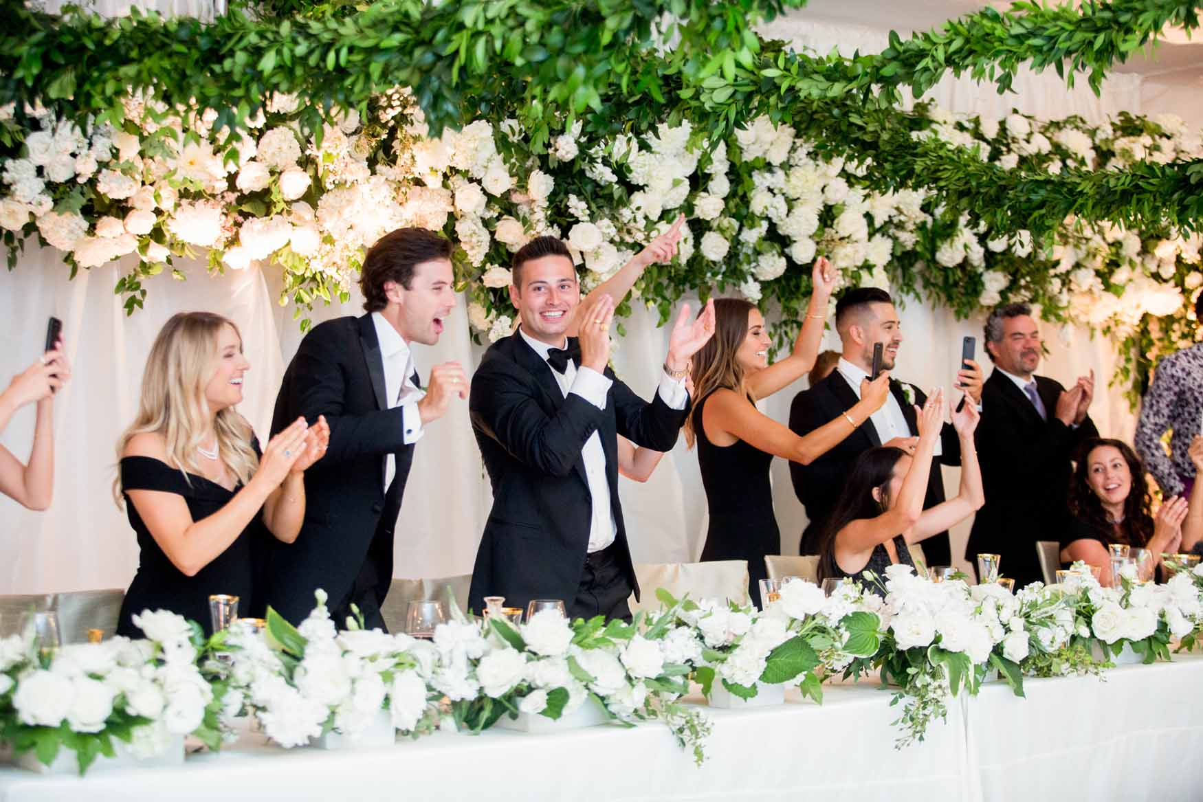 Luxurious wedding head table with flower wall backdrop