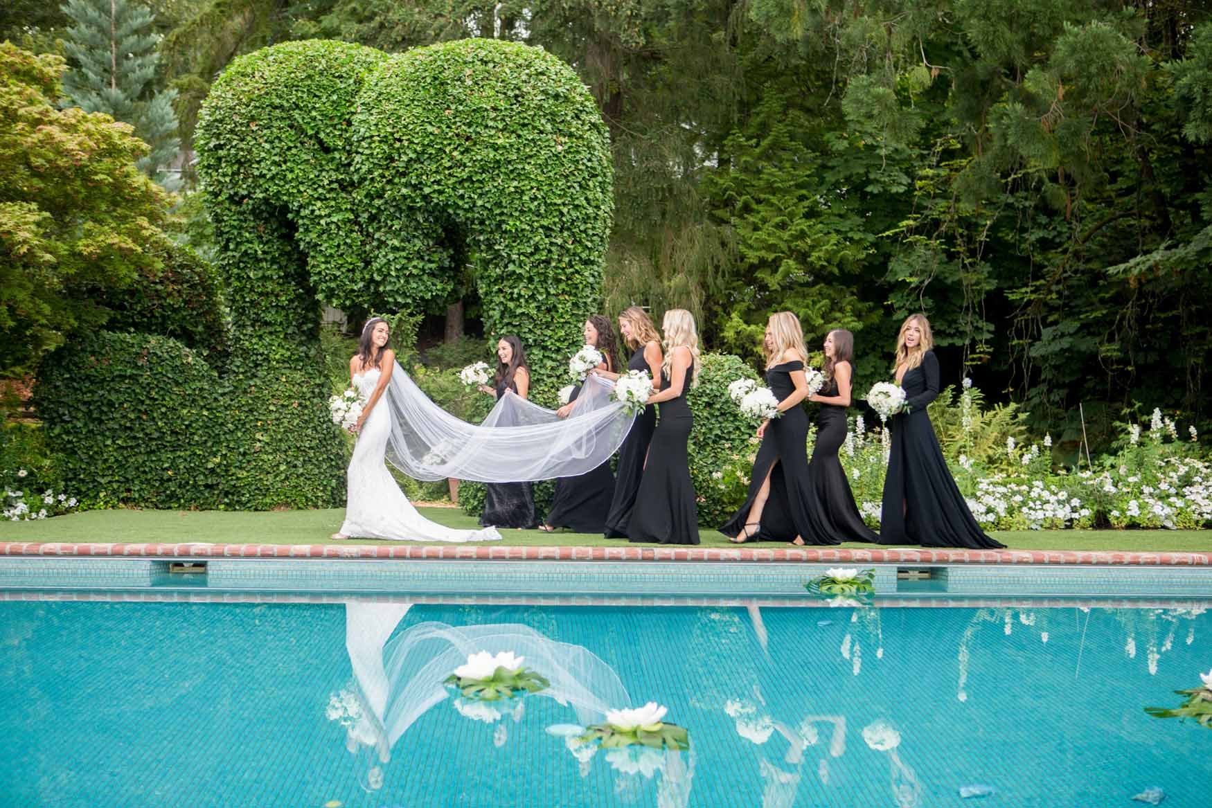 A bride and her bride's maids by the pool - Elegant Summer Private Estate Wedding. Flora Nova Design Seattle