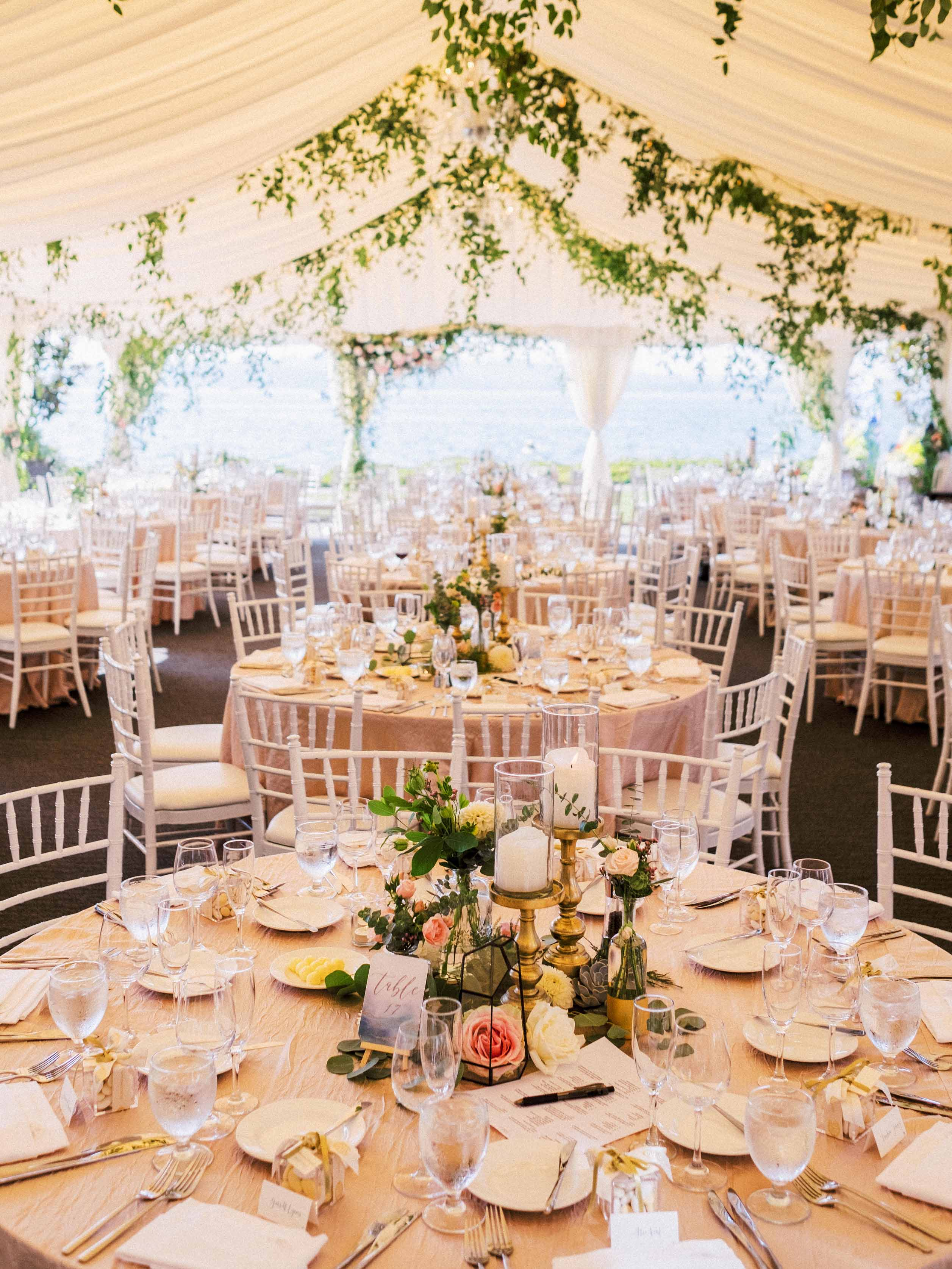 Guest tables at wedding reception, centerpieces with candles and blooms - Woodmark Hotel Wedding by Flora Nova Design Seattle