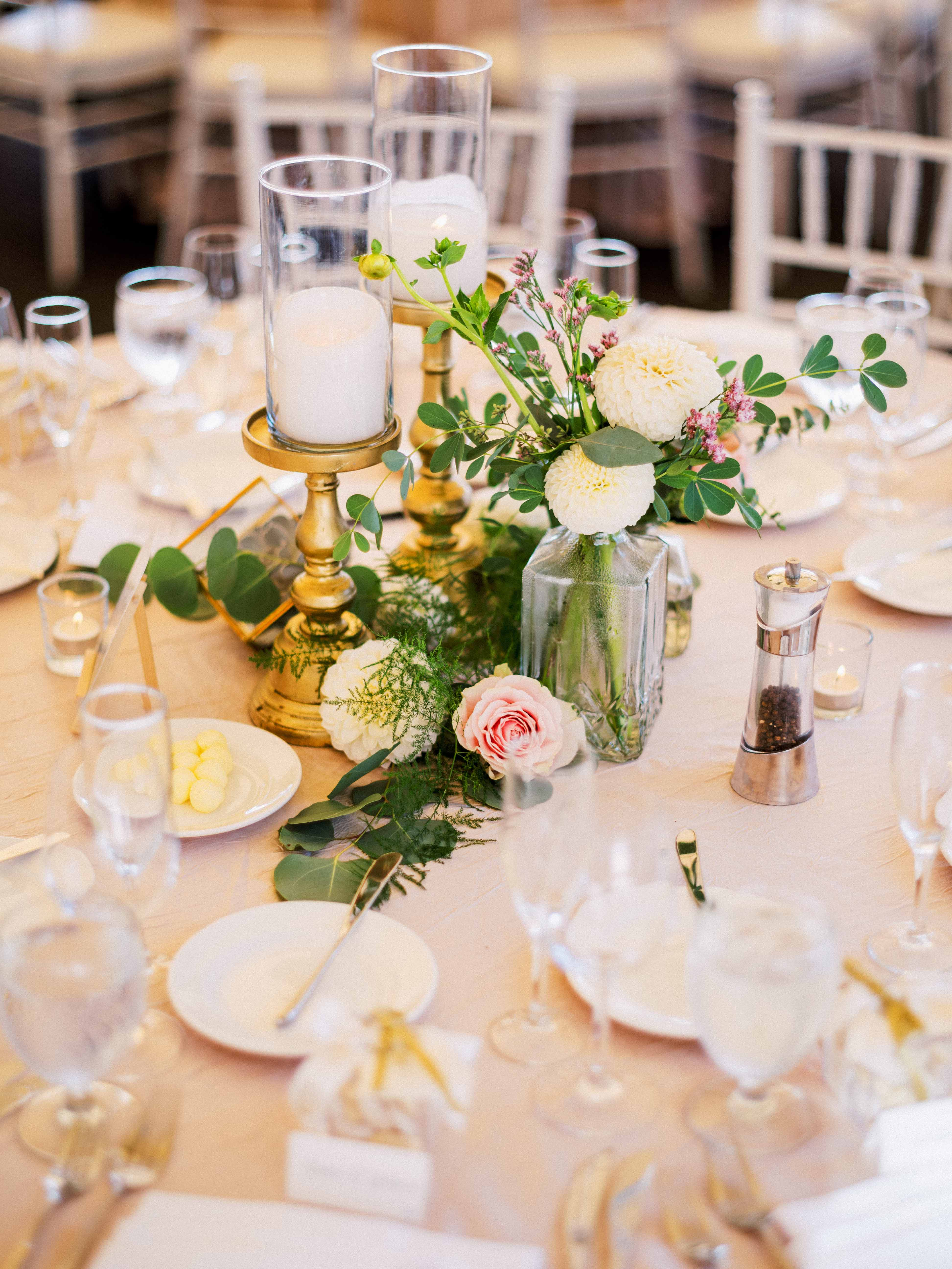 Composite style centerpiece with candles and greenery and blooms -  Woodmark Hotel Wedding by Flora Nova Design Seattle