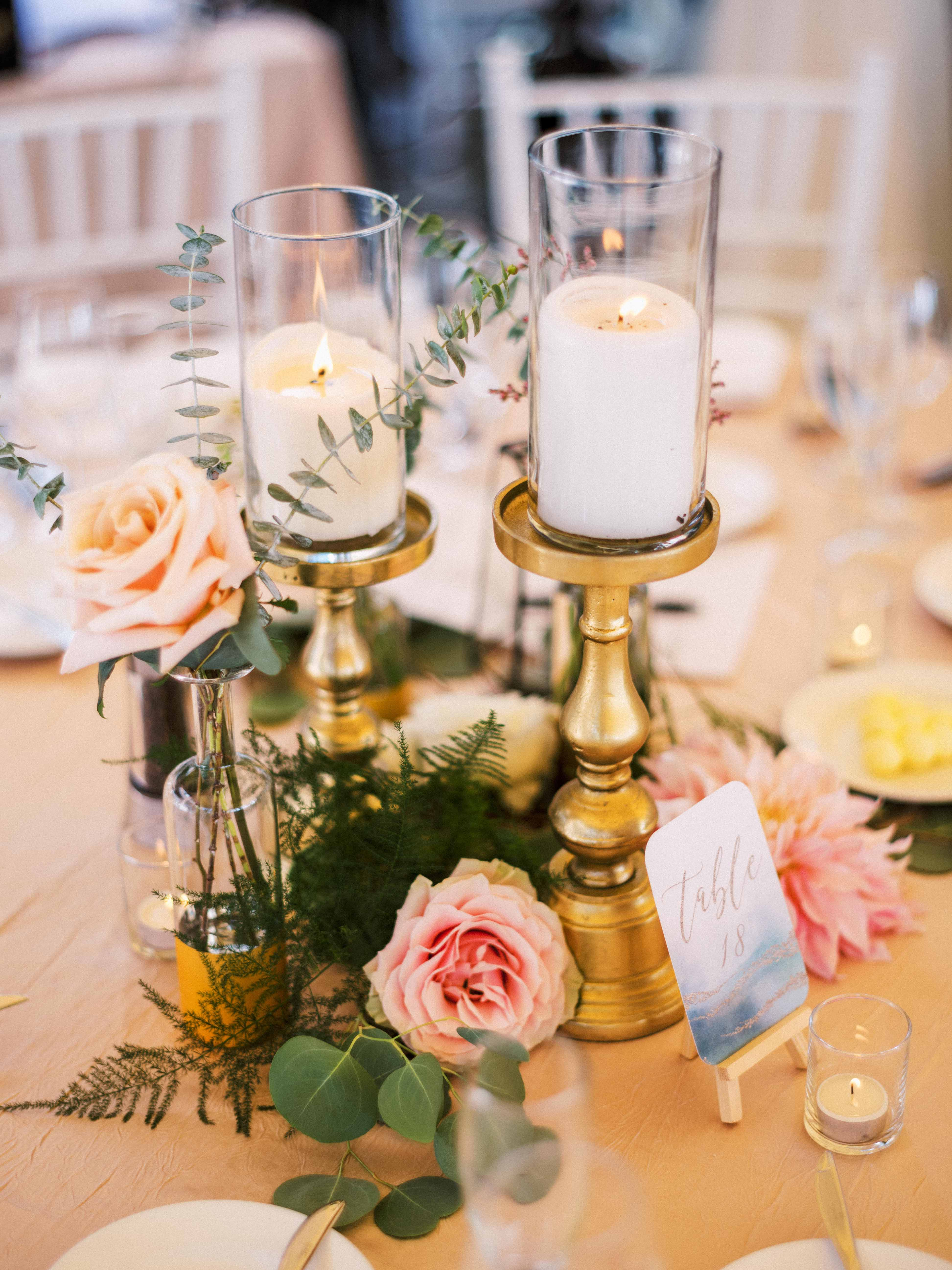 Wedding centerpiece with gold candles, blooms, and greenery - Woodmark Hotel Wedding by Flora Nova Design Seattle