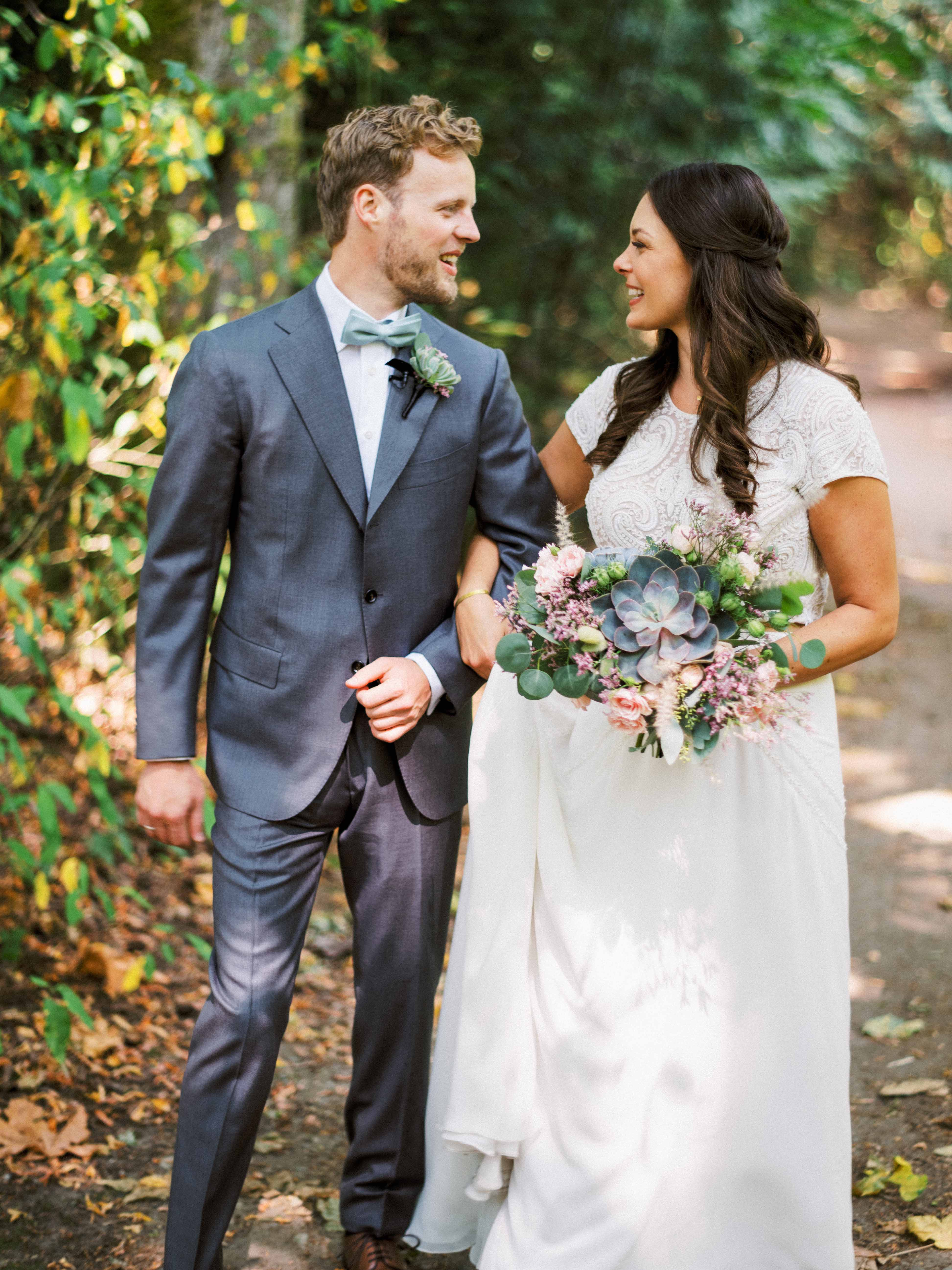 Wedding couple with bride holding succulent bouquet - Woodmark Hotel Wedding by Flora Nova Design Seattle