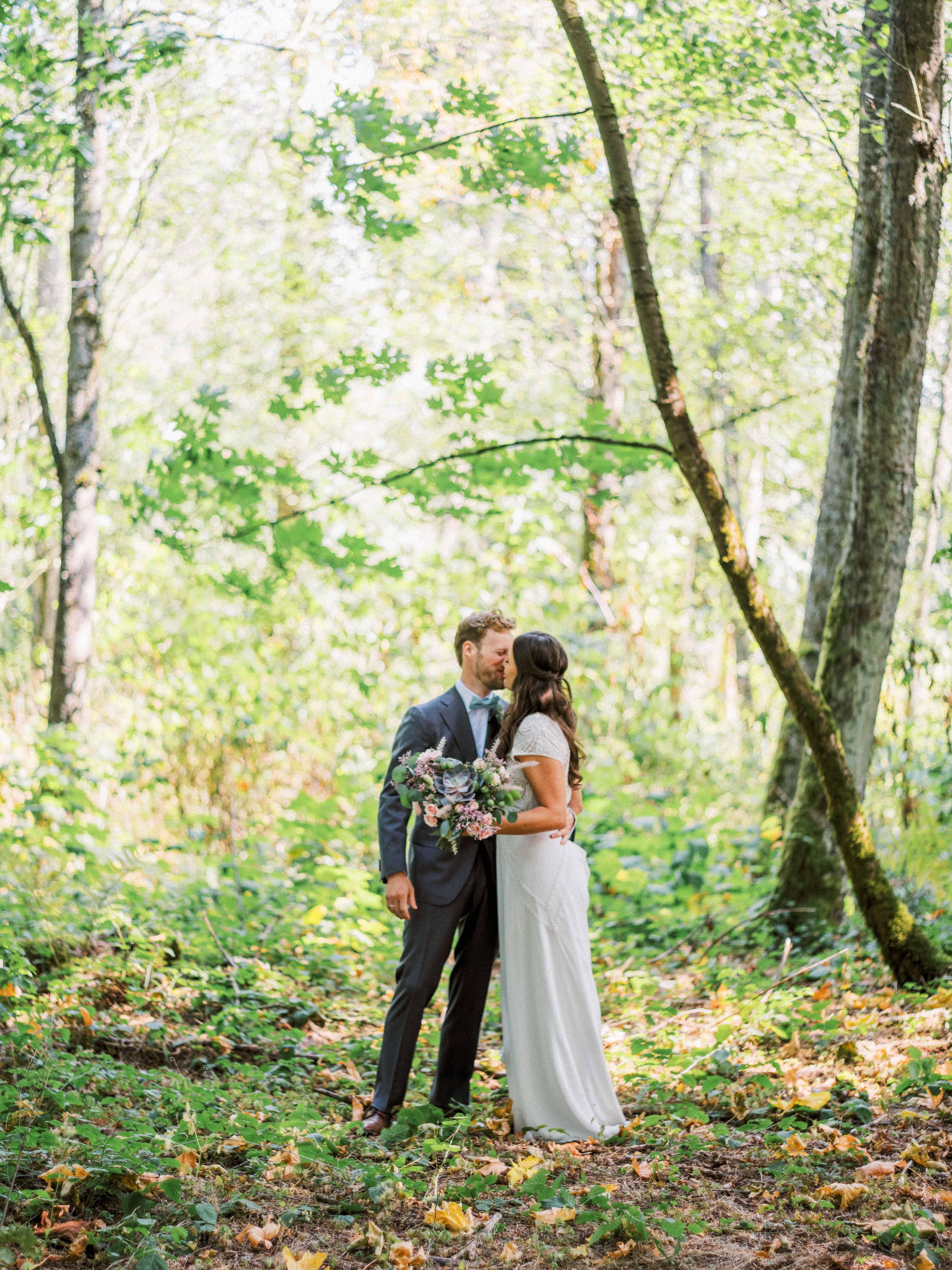 Wedding couple in forest  - Woodmark Hotel Wedding by Flora Nova Design Seattle