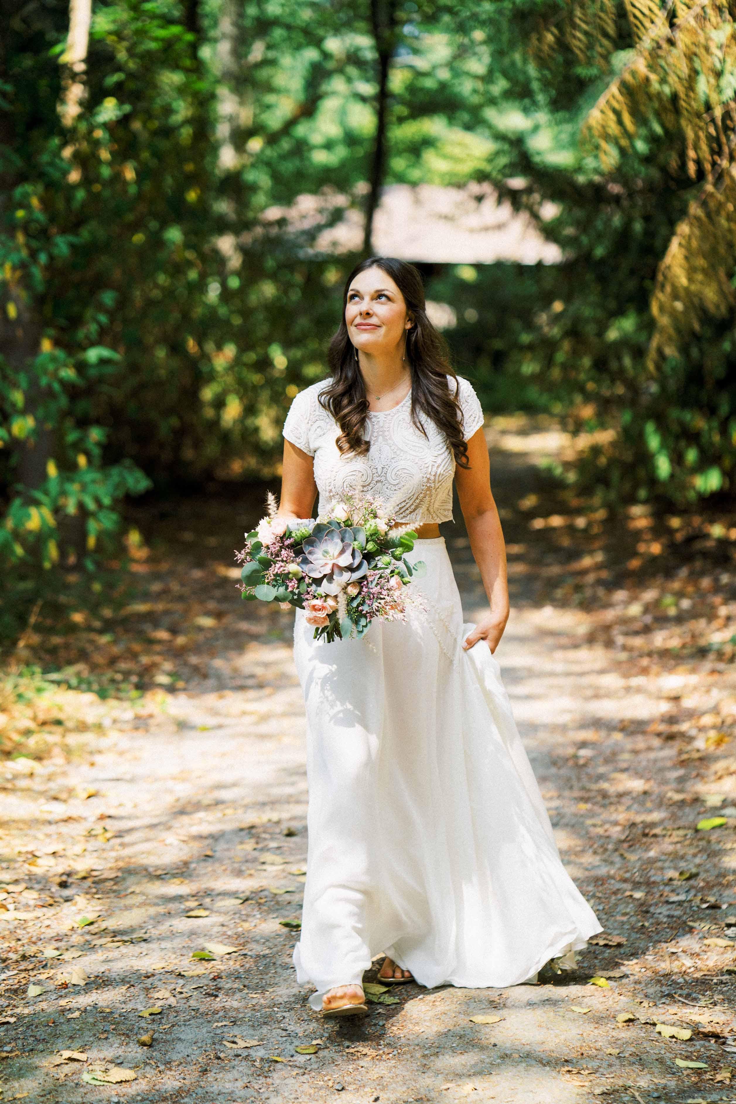 Bride with succulent bouquet - Woodmark Hotel Wedding by Flora Nova Design Seattle