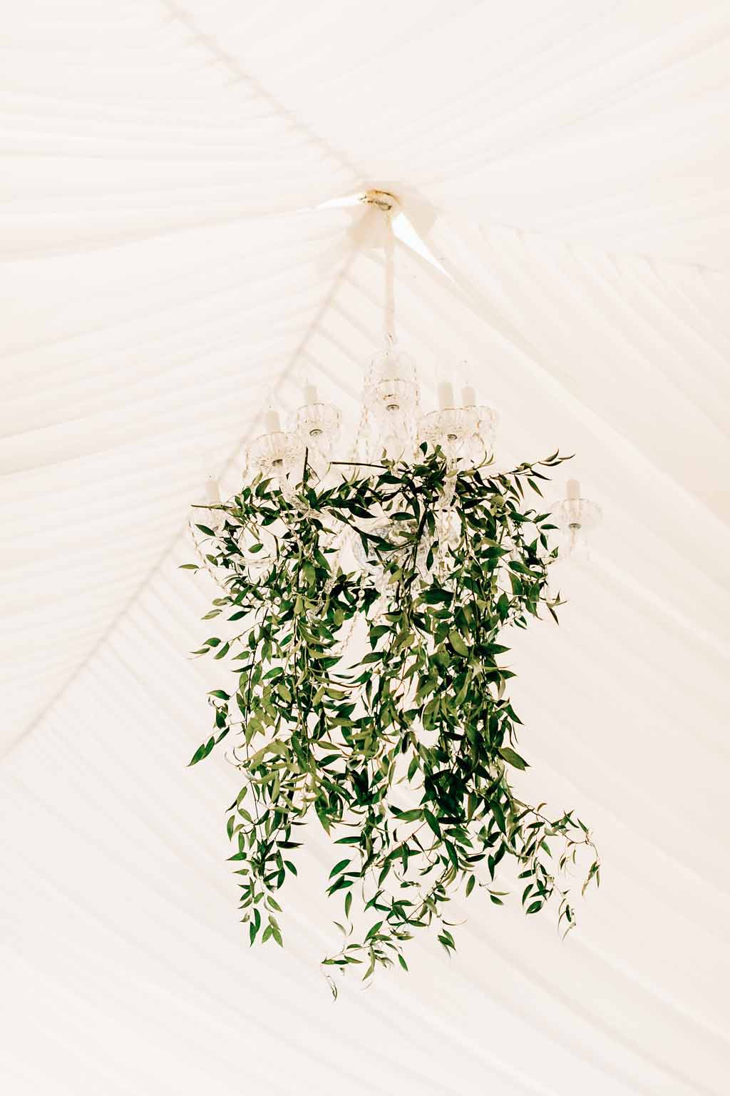 greenery chandelier in wedding reception tent