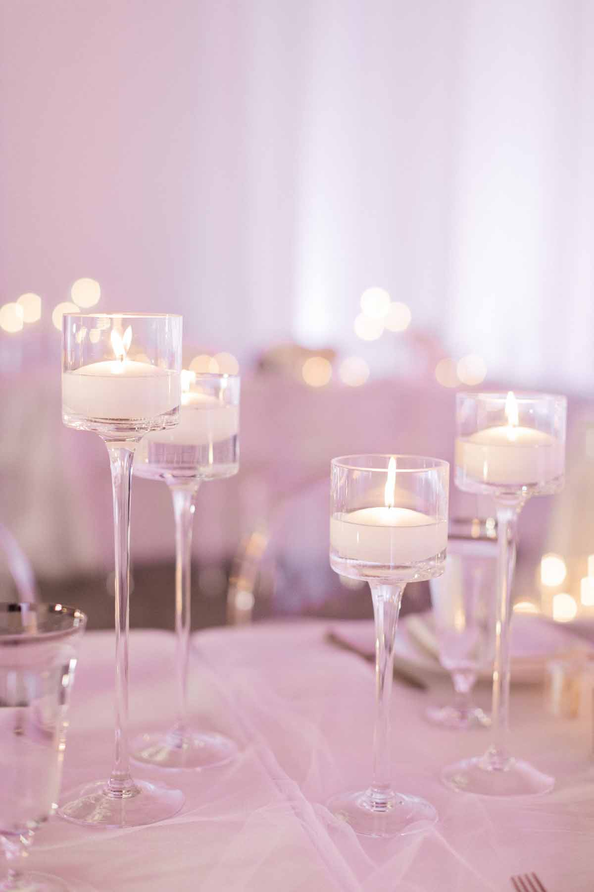 Floating candles at wedding reception