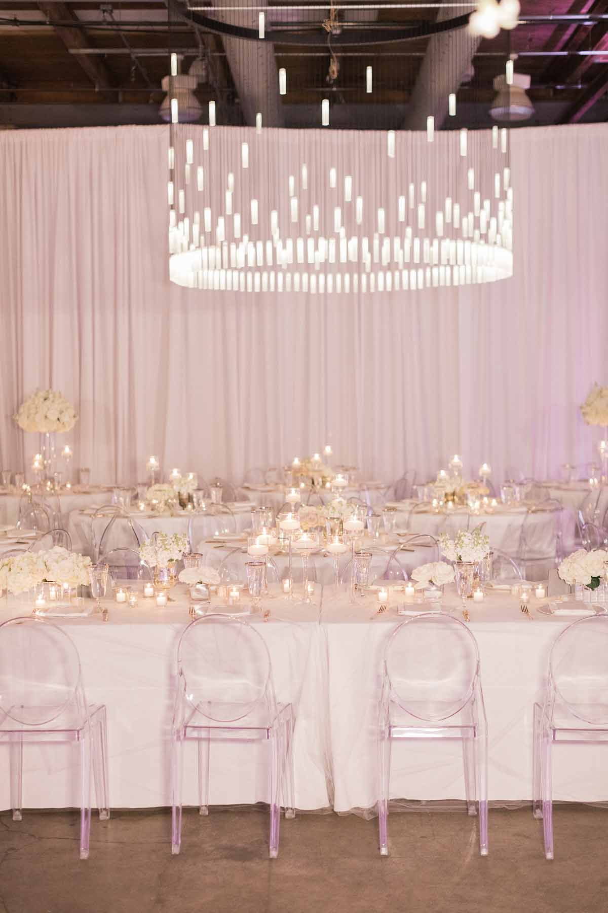 Grand crystal chandelier at all white reception at Canvas Event Space wedding in Seattle