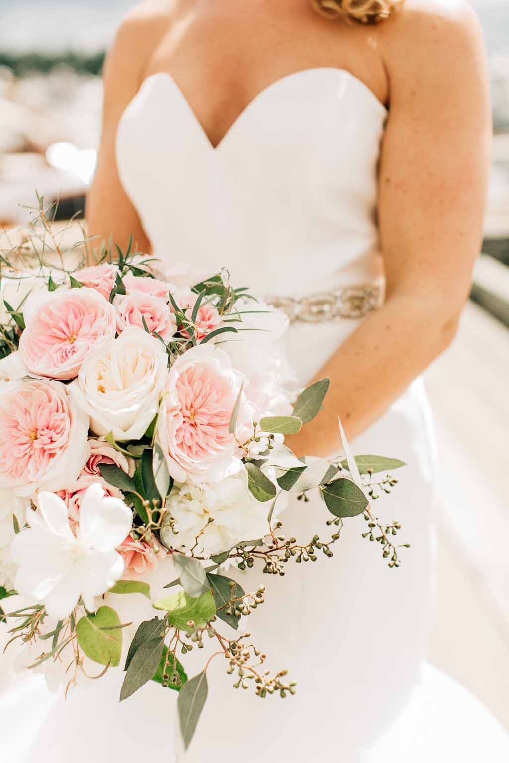 Bride holding her bridal bouquet of  Juliet garden roses, peonies, and trailing greenery vines for  her spring Lake Washington Wedding - designed by Flora Nova Design Seattle