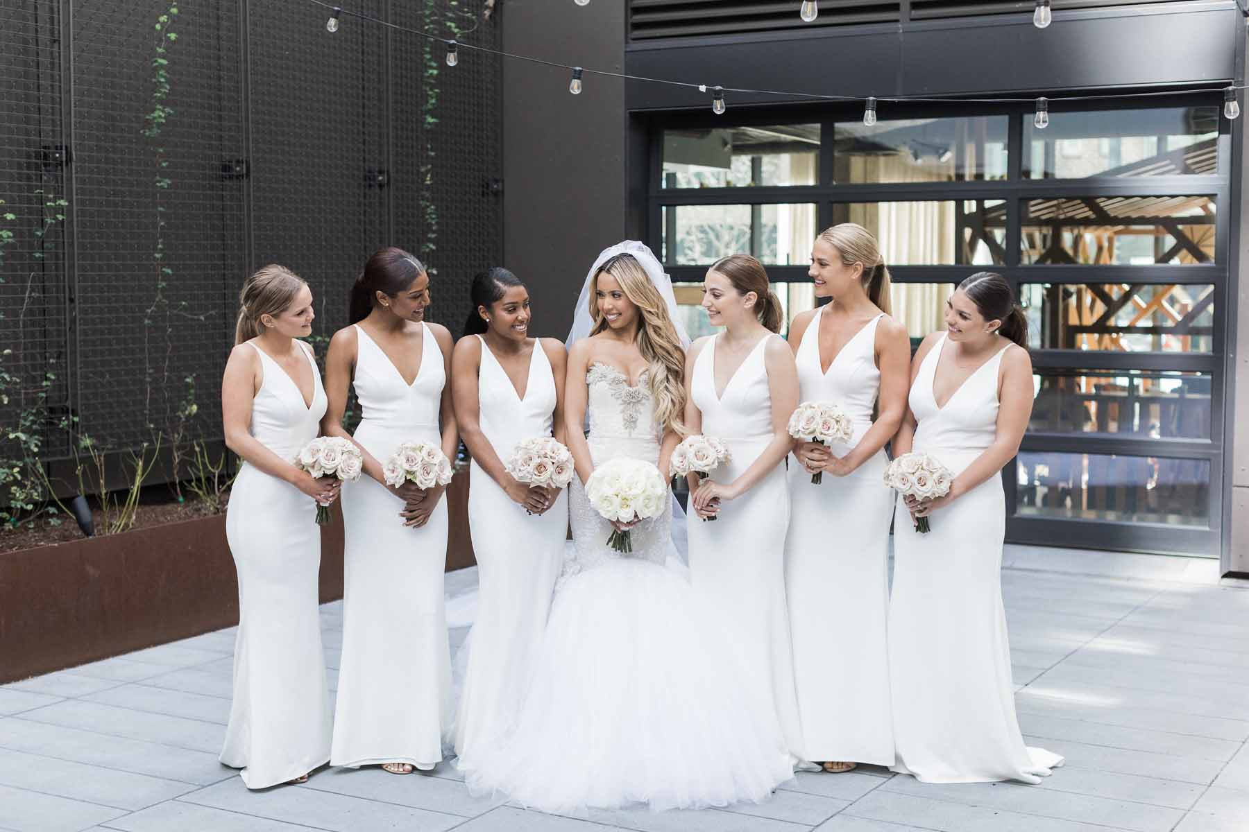 A bridal party in all white dresses