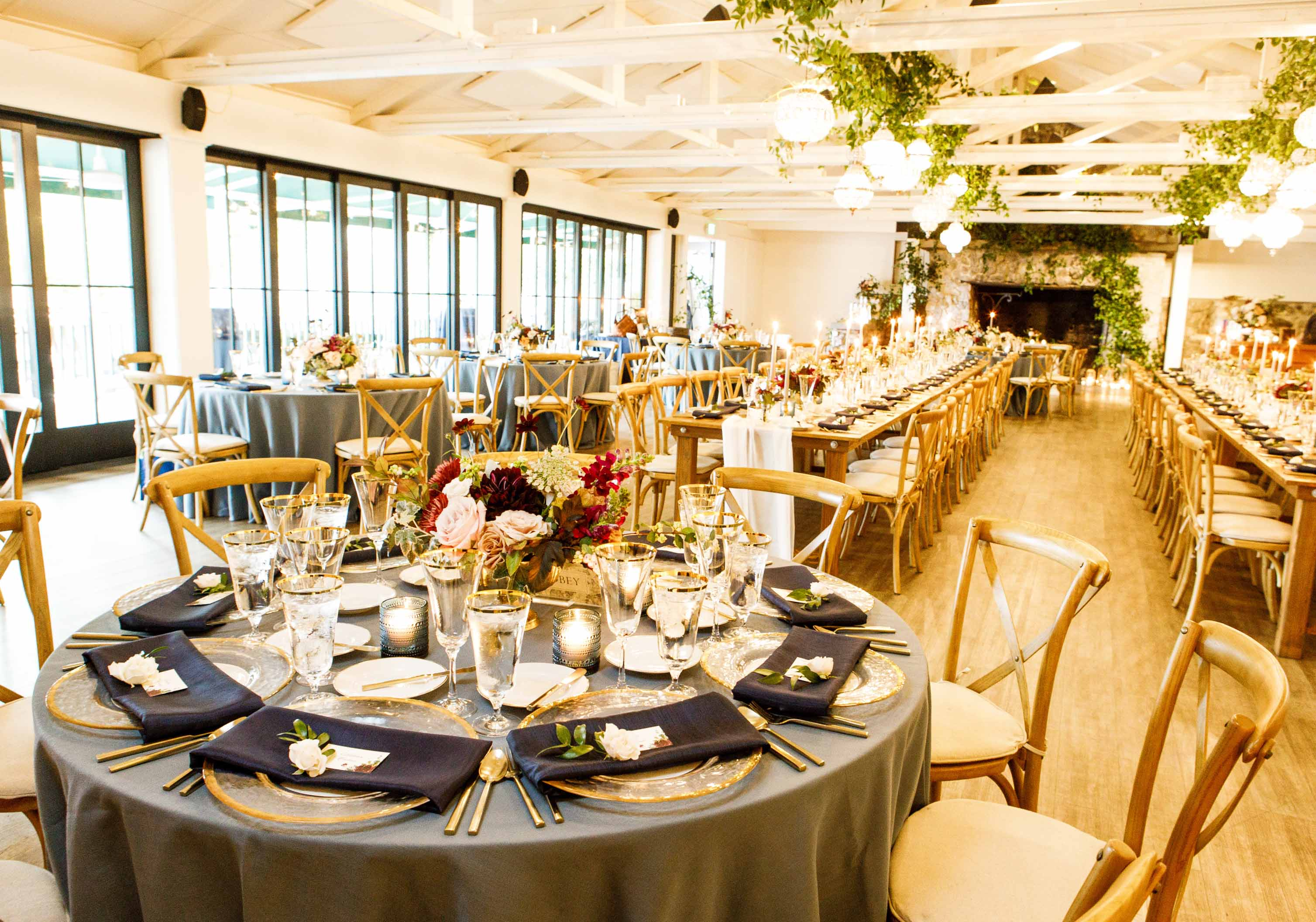 A mix of round and long tables for a dinner reception