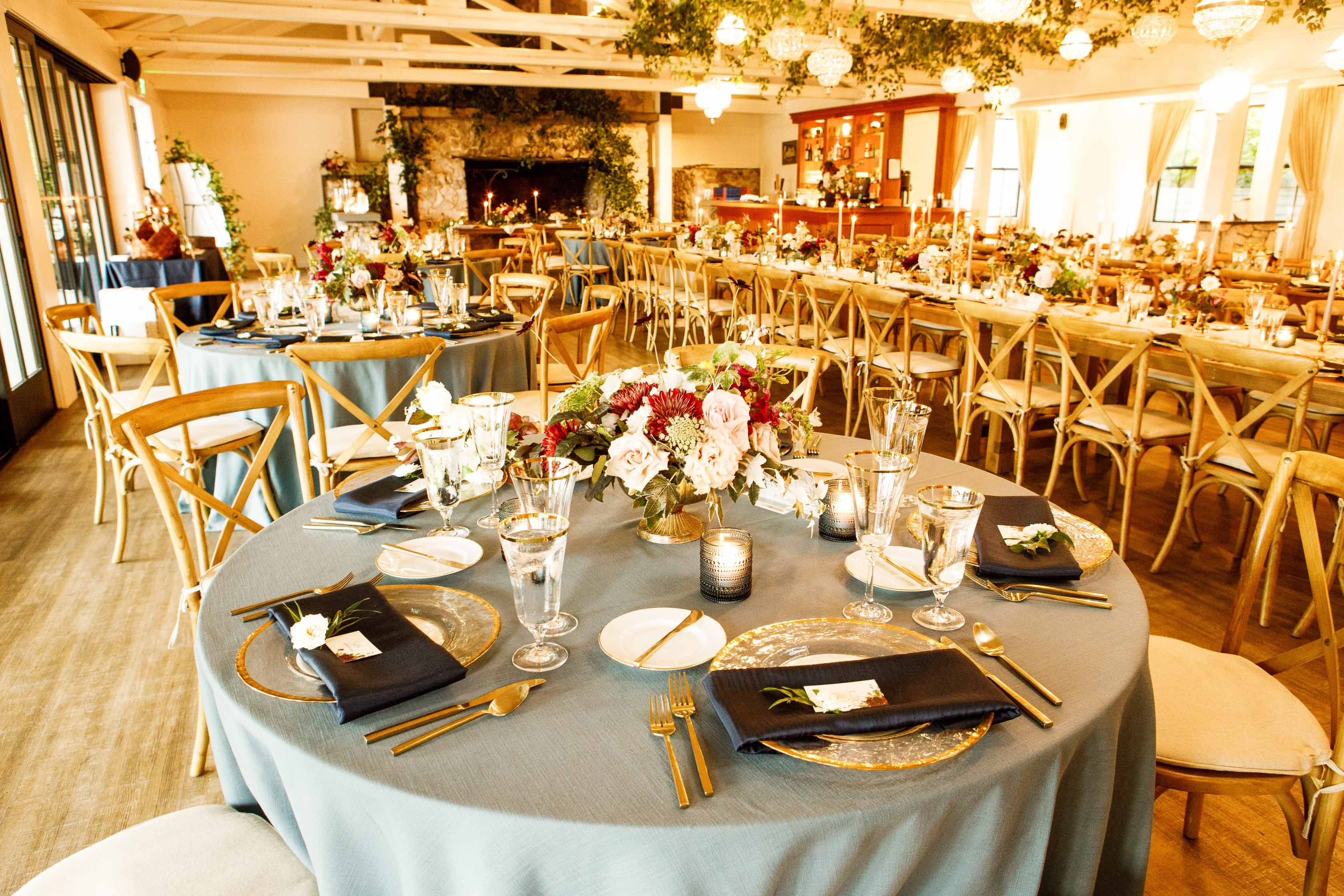 Wedding reception at Roche Harbor Resort with French blue linens and fall flowers