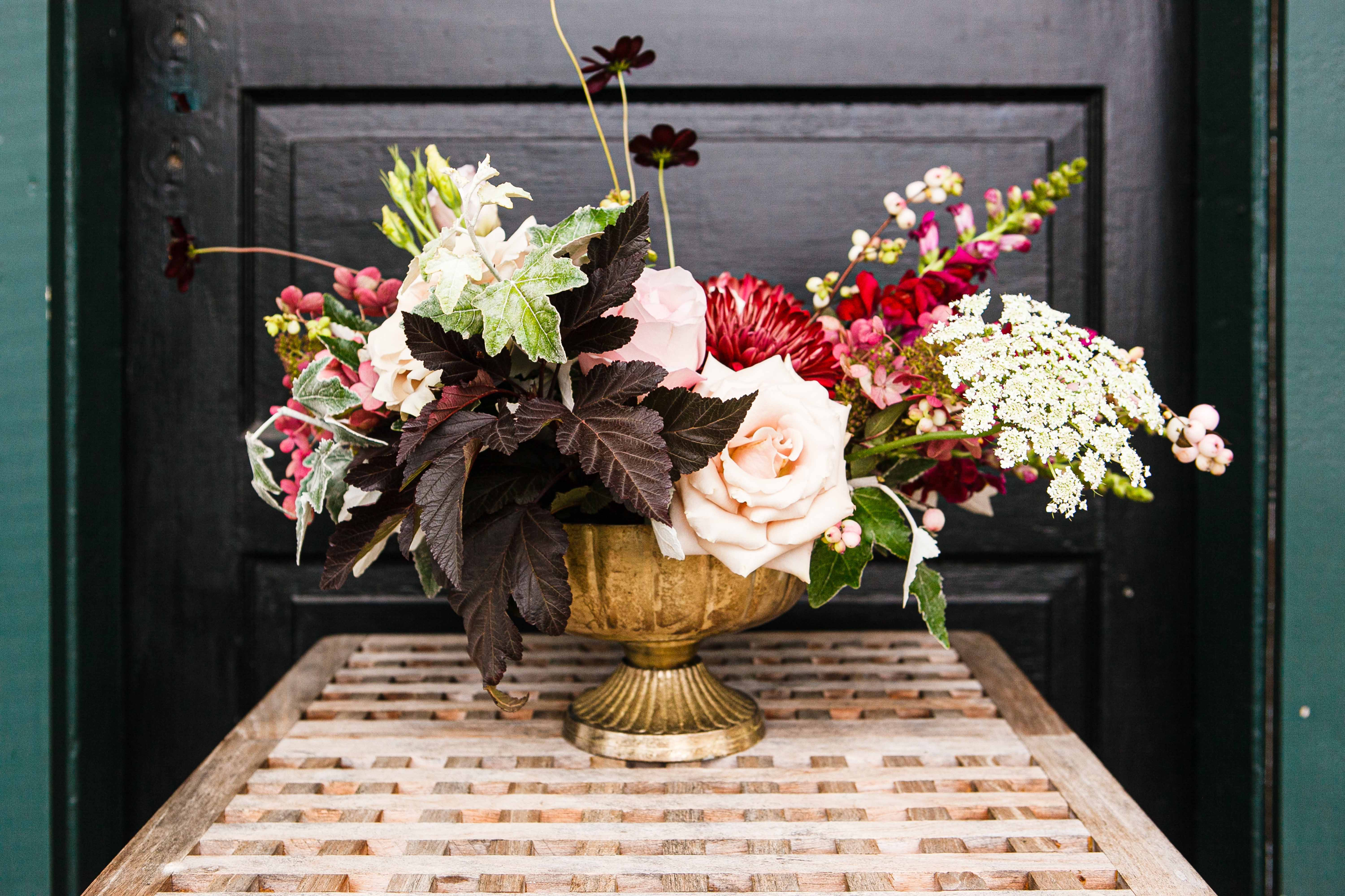 A compote arrangement with fall flowers