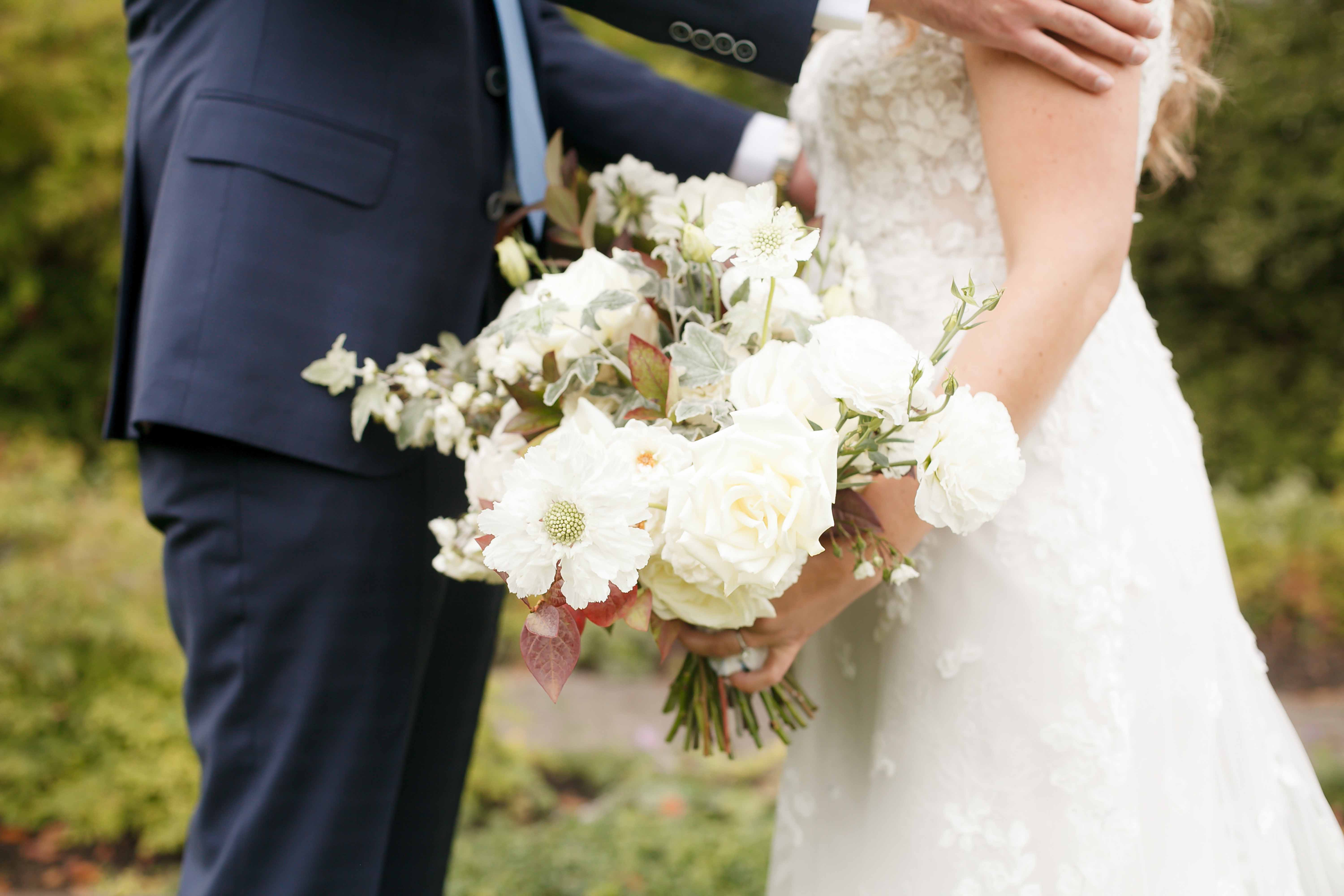 Fall bridal bouquet in cream with fall textures