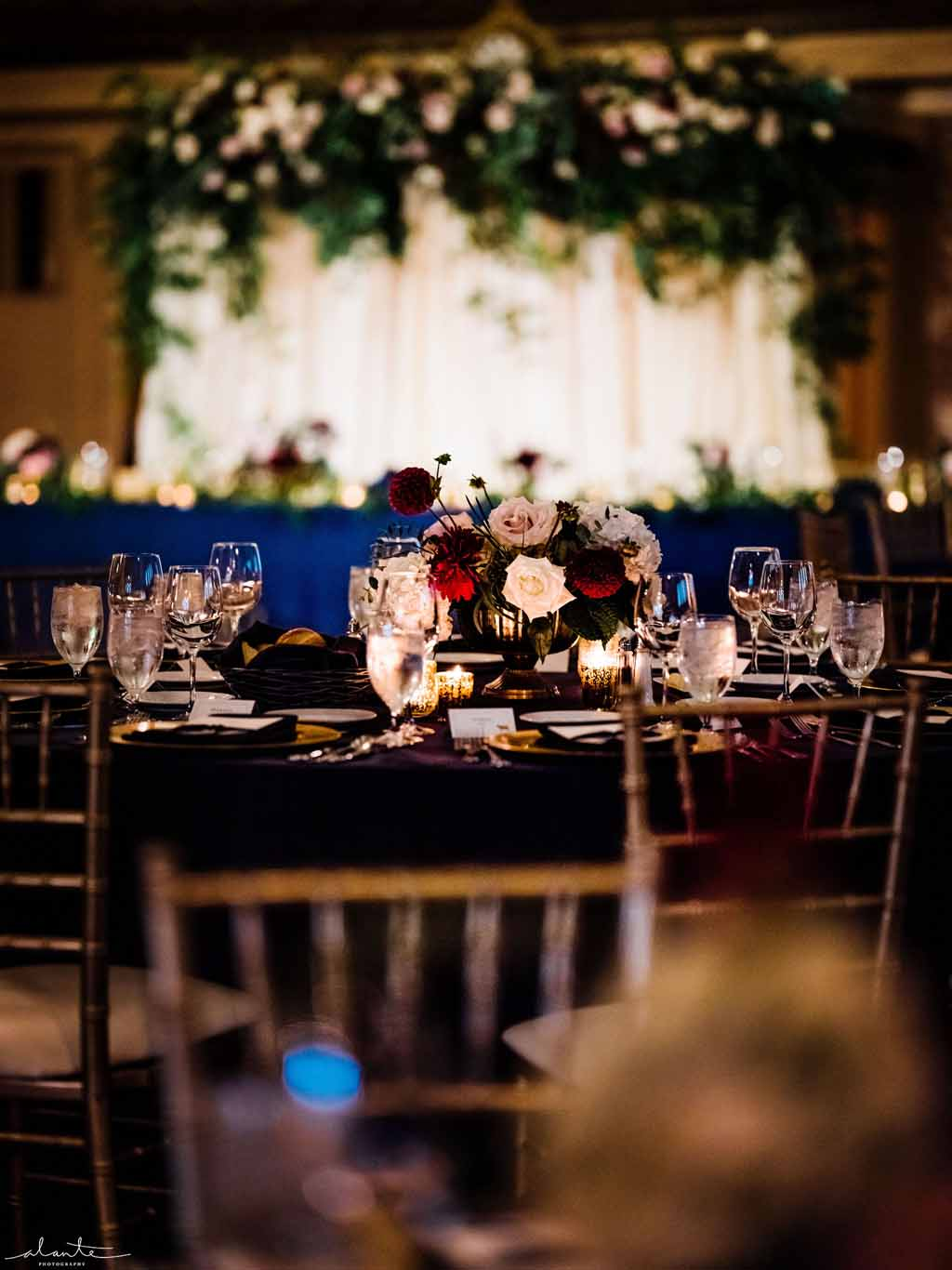 Wedding reception centerpiece in burgundy and navy