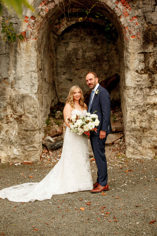 Wedding couple with fall wedding bouquet, designed by Flora Nova Design