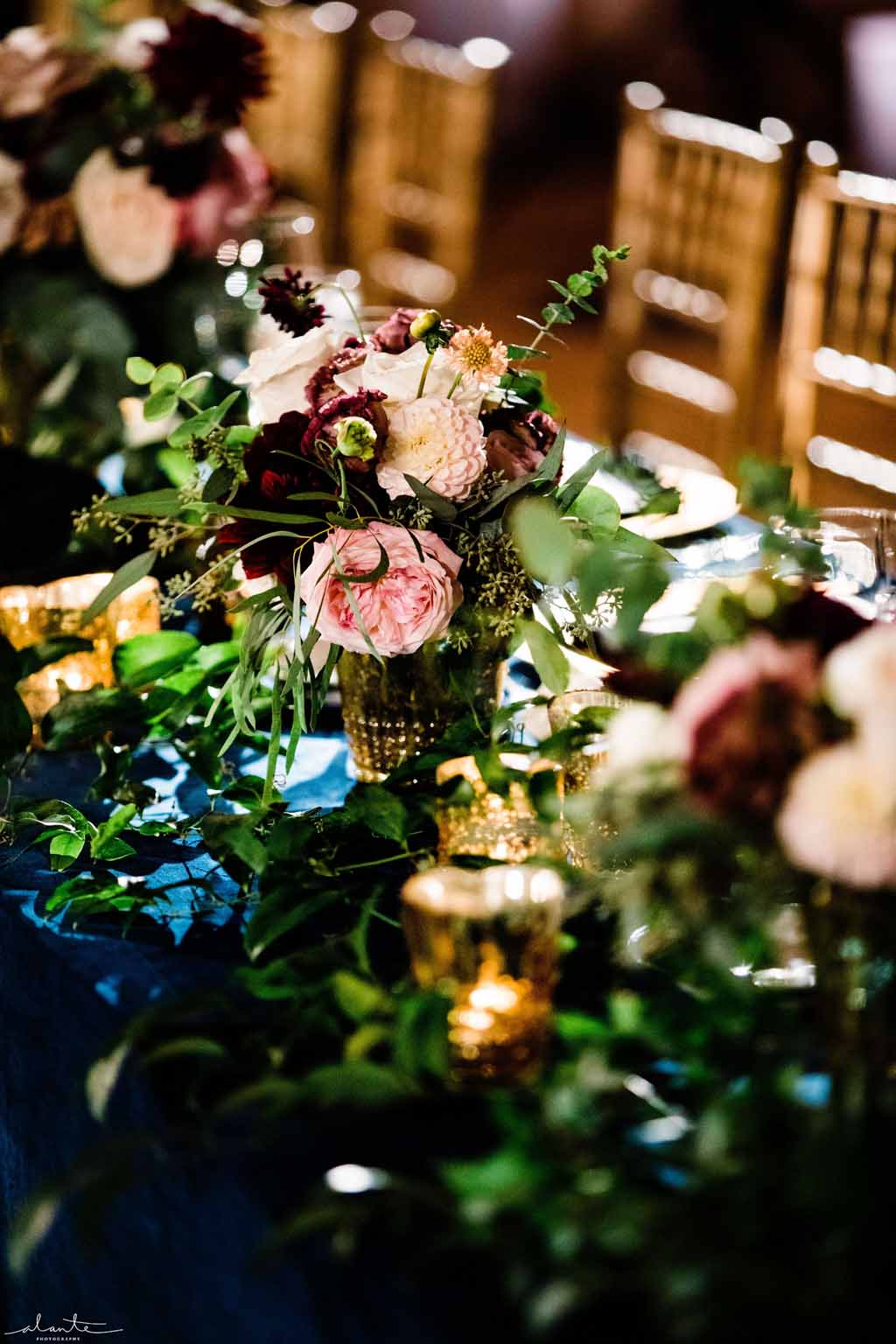 Head table flowers in burgundy and blush with navy accents